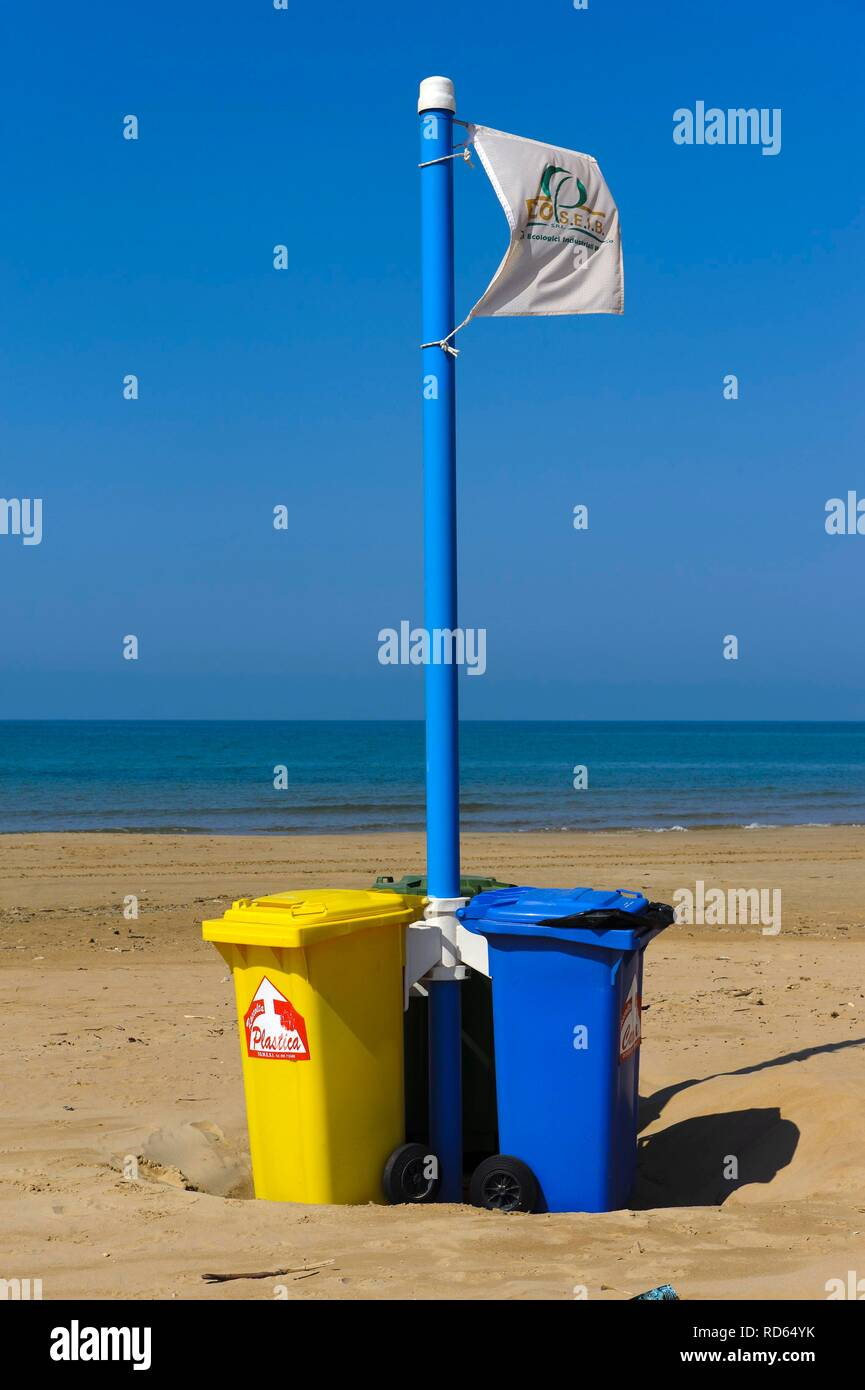 Trash cans for wate separation on the beach of Donnalucata, Sicily, Italy, Europe - Stock Image