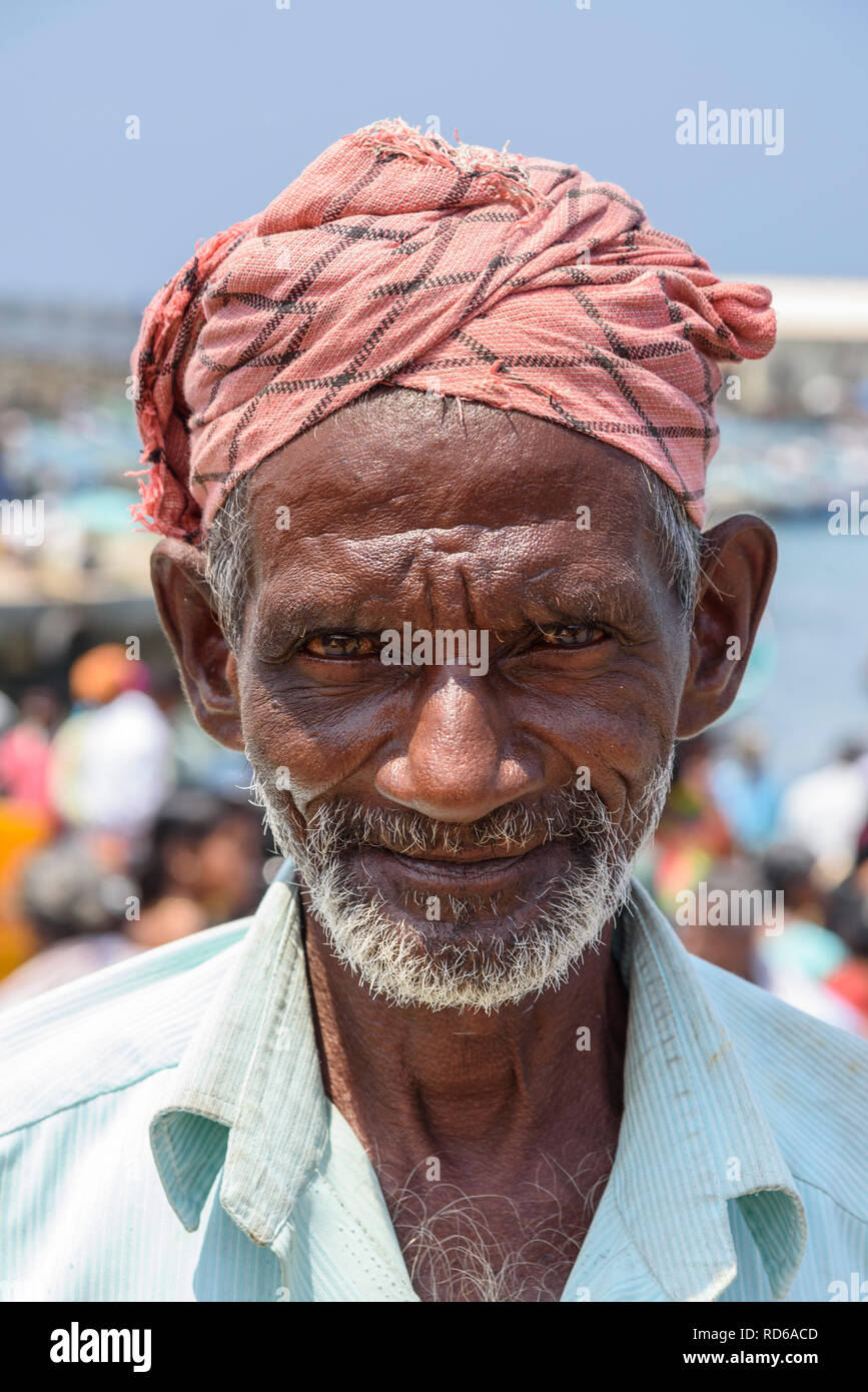 Fisherman. Vizhinjam beach fish market, near Kovalam, Kerala, India - Stock Image
