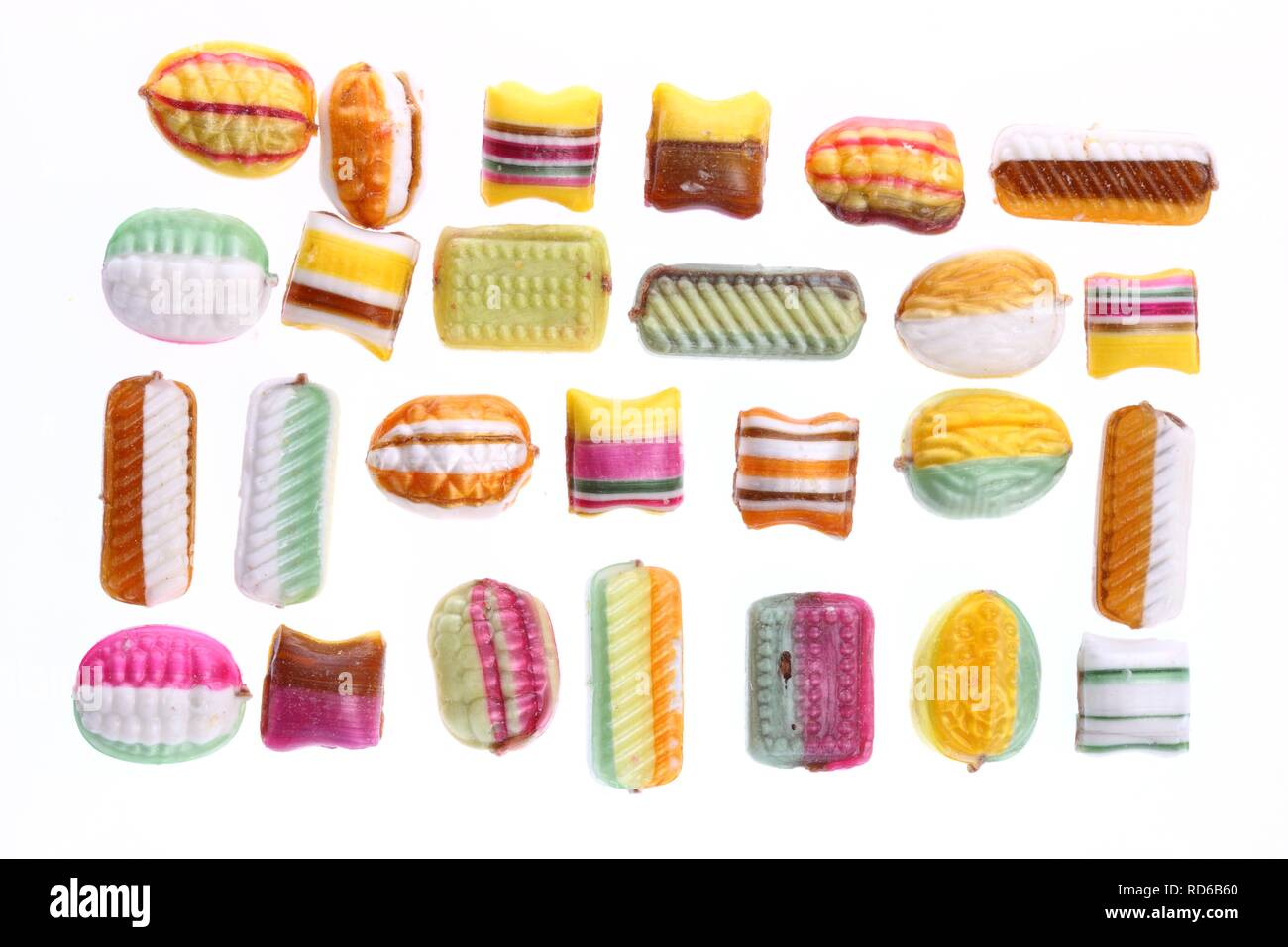 Boiled sweets or drops with different shapes and motifs - Stock Image