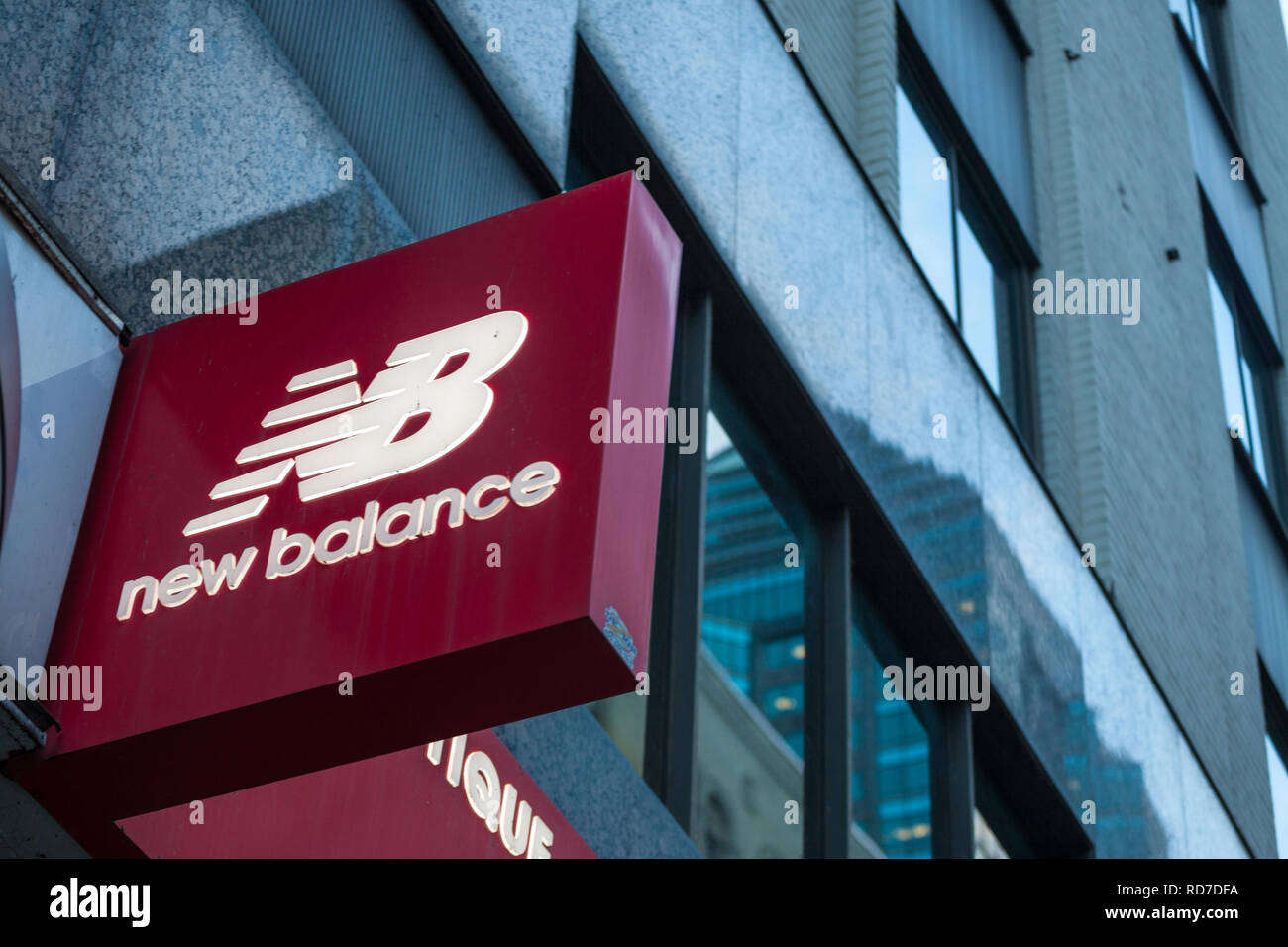MONTREAL, CANADA - NOVEMBER 7, 2018: New Balance logo in front of their main retailer in Montreal, Quebec. New Balance is an American sports footwear  - Stock Image