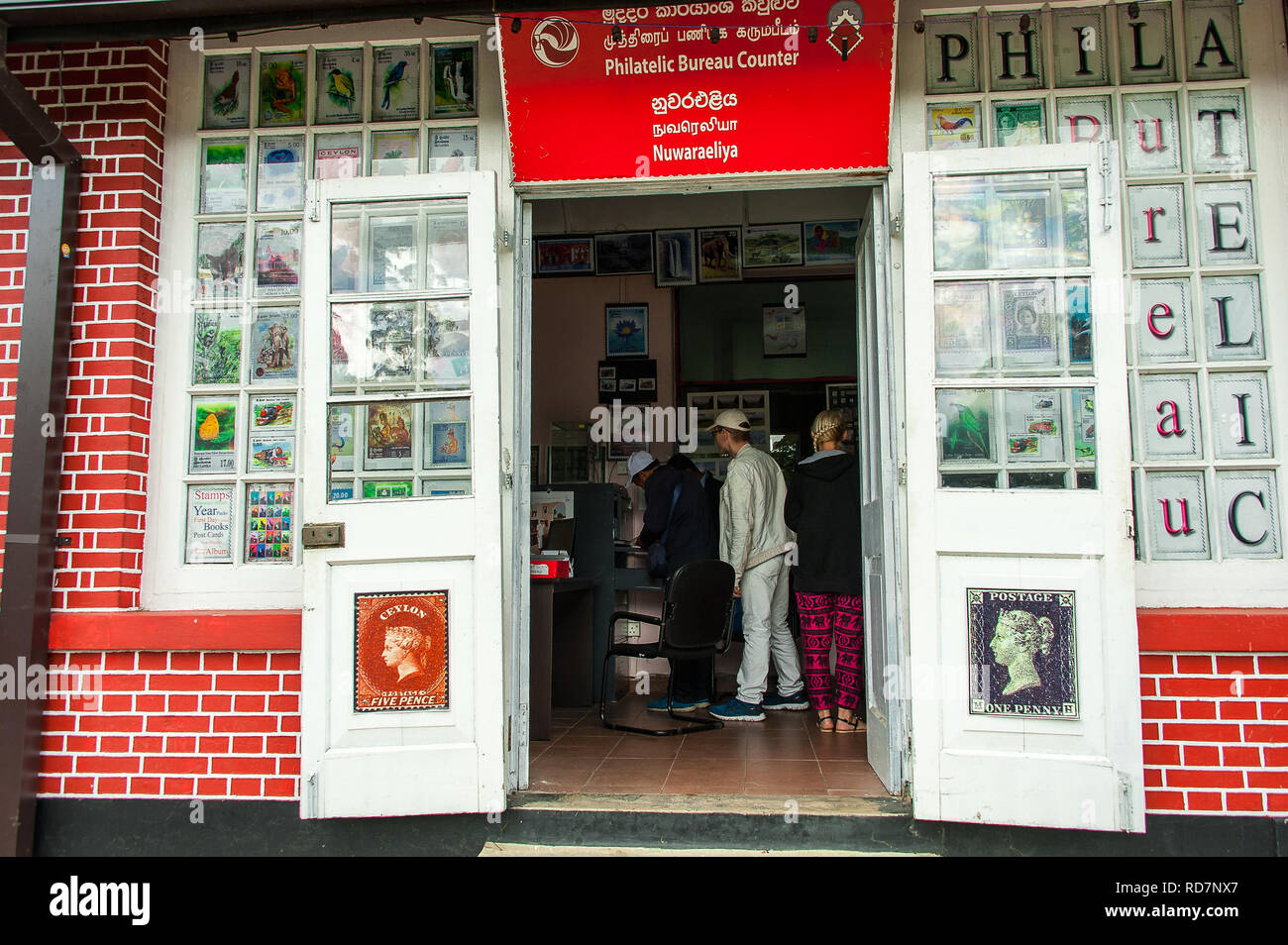 Nuwara Eliya, Sri Lanka: View to Phalatelic Centre inside the historic Post Office building with people  waiting in a queue. - Stock Image