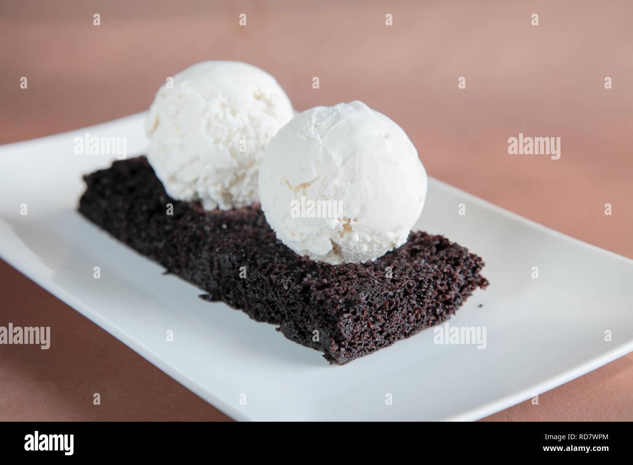 Chocolate Brownie with Vanilla Ice Cream Stock Photo