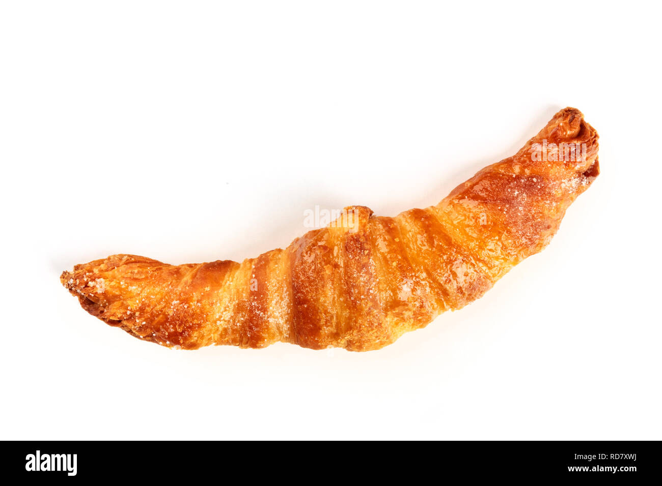 A croissant, shot from above on a white background with copy space - Stock Image
