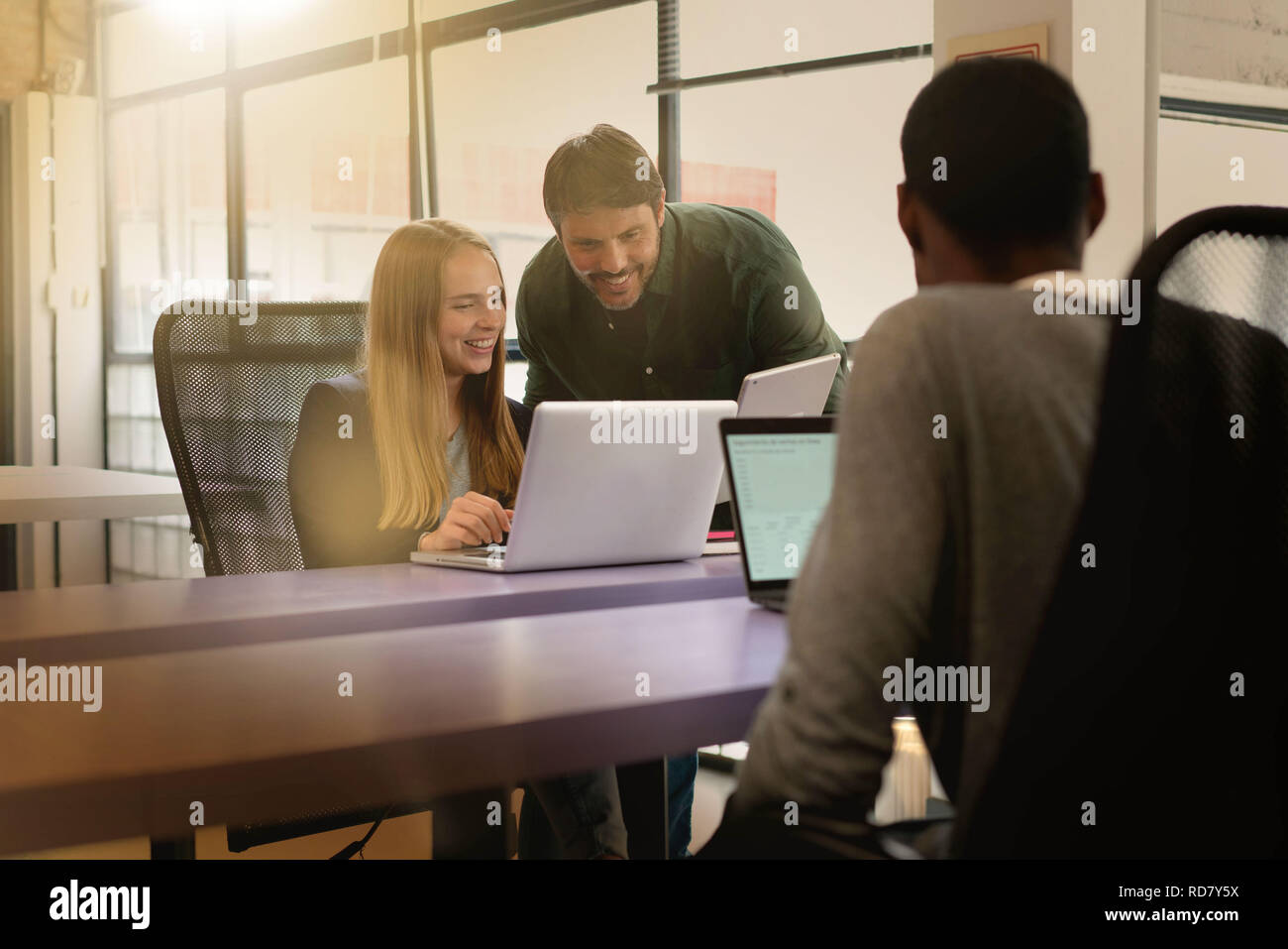 Co workers busy working in modern office space - Stock Image