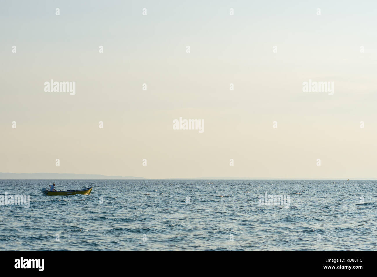 Man In Small Wooden Boat Stock Photos Man In Small Wooden Boat