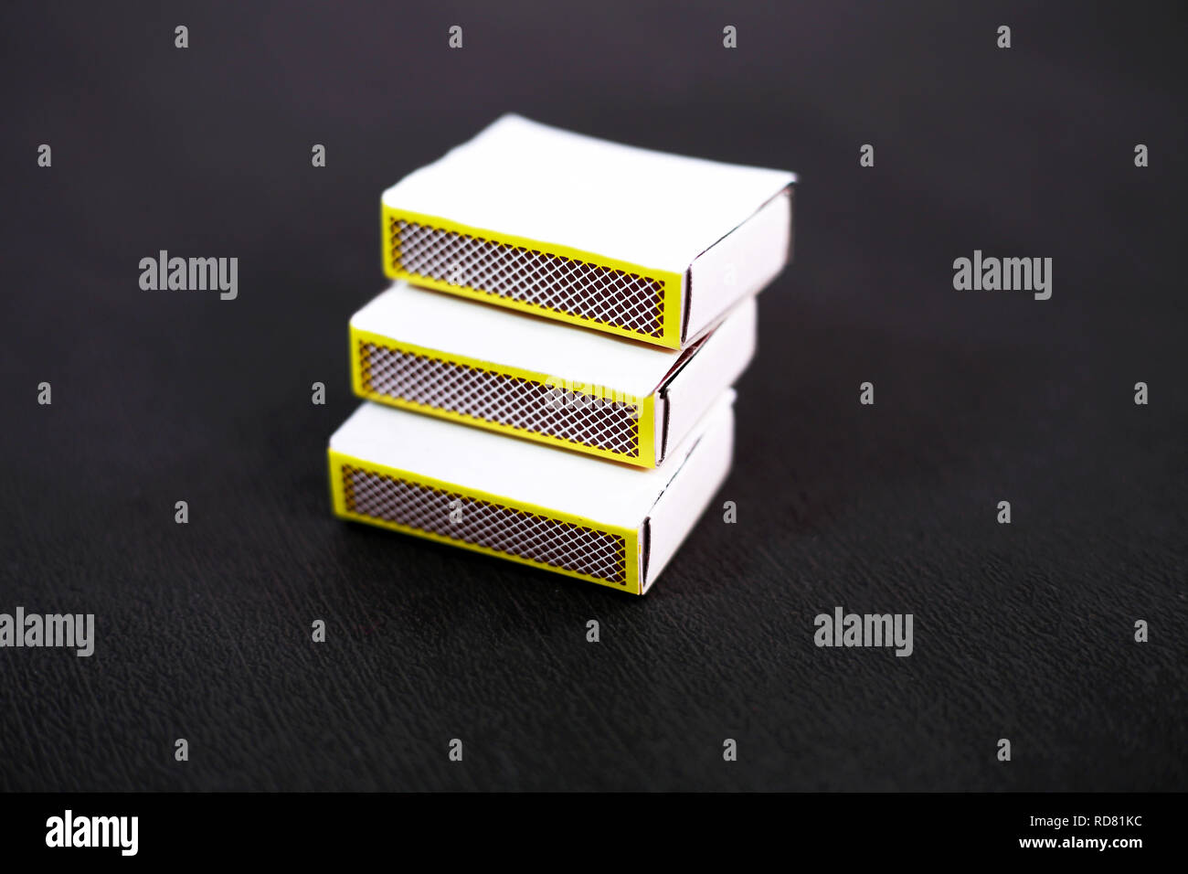 Portrait of match box. Isolated on the black background. - Stock Image