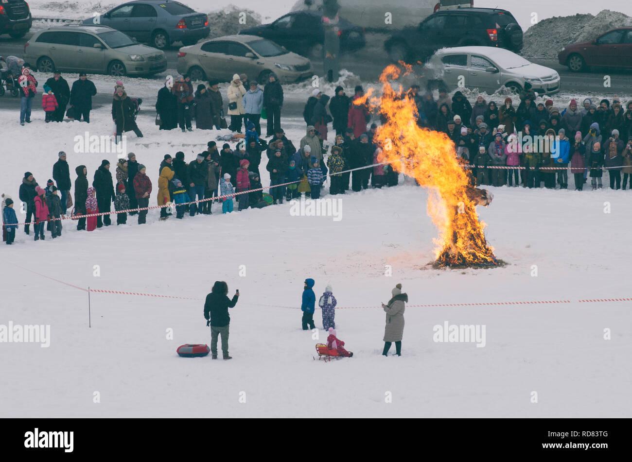 Saint Petersburg , Russia - February 17, 2018: Russian holiday Maslenitsa. The burning of the straw figure symbolizing winter. - Stock Image