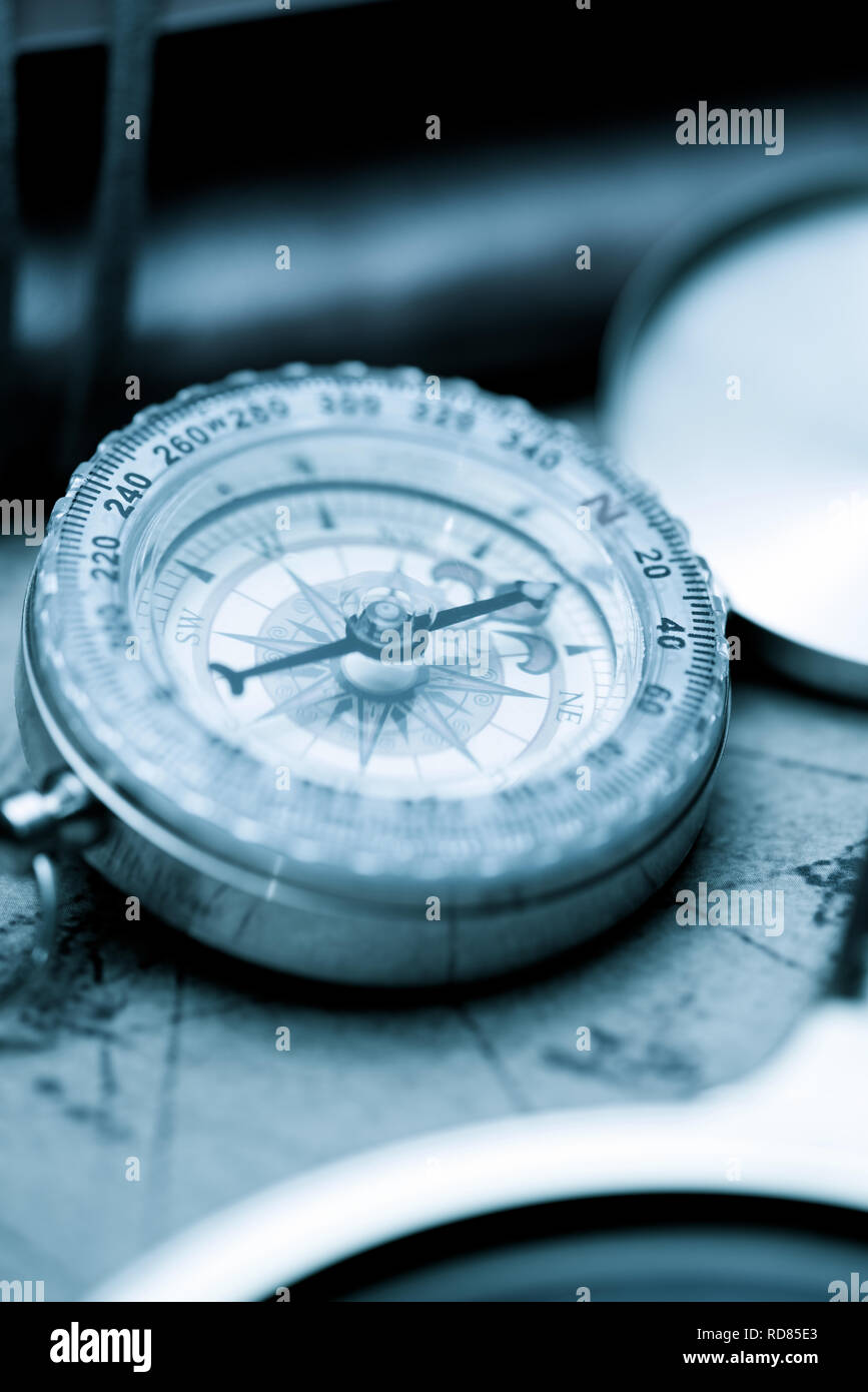 Vintage compass and old navigation map. - Stock Image