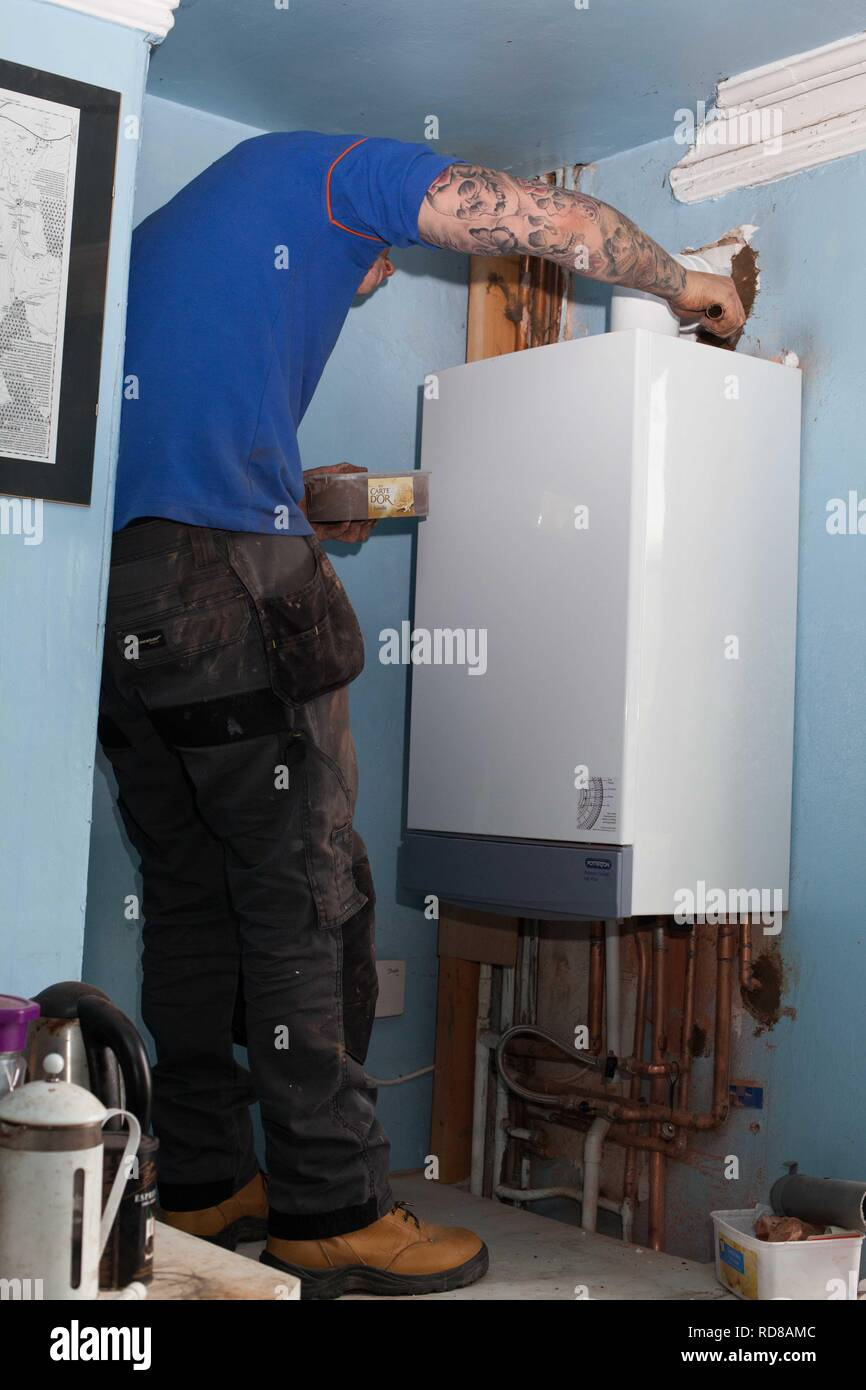 British Gas Removing Old Inefficient Boiler Which Creates Too Much Co2 Into The Atmosphere To Be Replaced By New Efficient Model Uk Government Initiative To Meet International Targets On Climate Change Such
