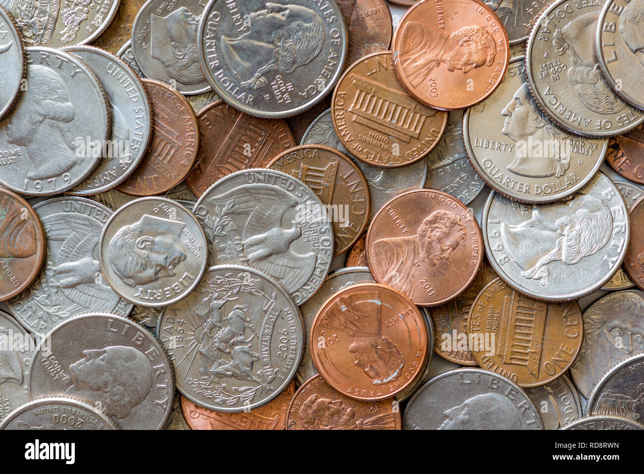 Close-up of a one cent, 10 cent and a quarter coins - Stock Image