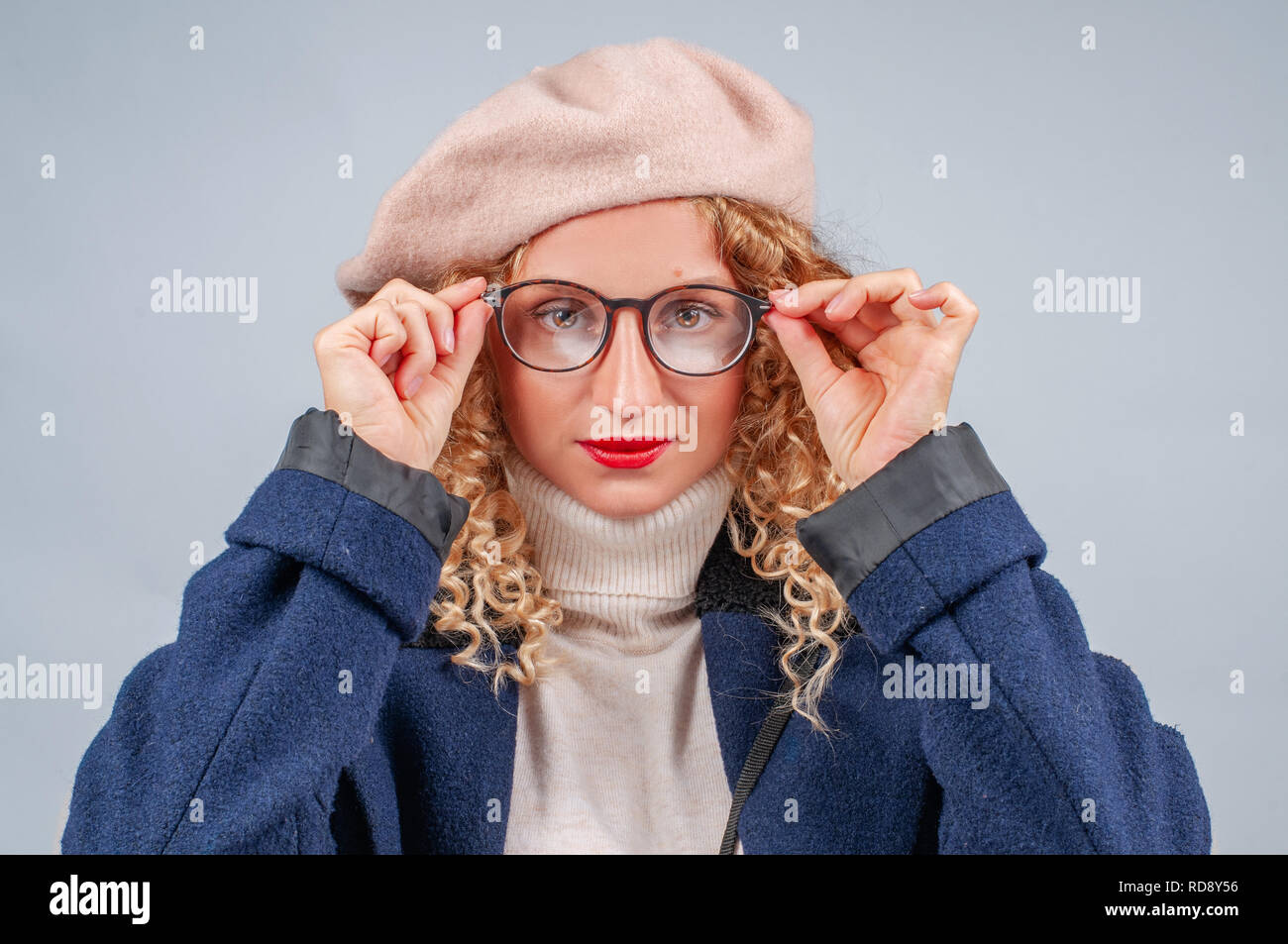 776124ff8ea9c Happy student woman in eyeglasses and beret is smiling and looking at  camera - Stock Image