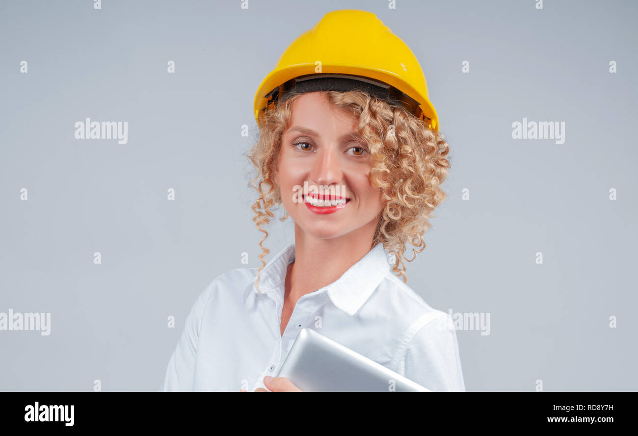 3a3e8ade675 Business woman engineer in yellow safety helmet with tablet computer ...