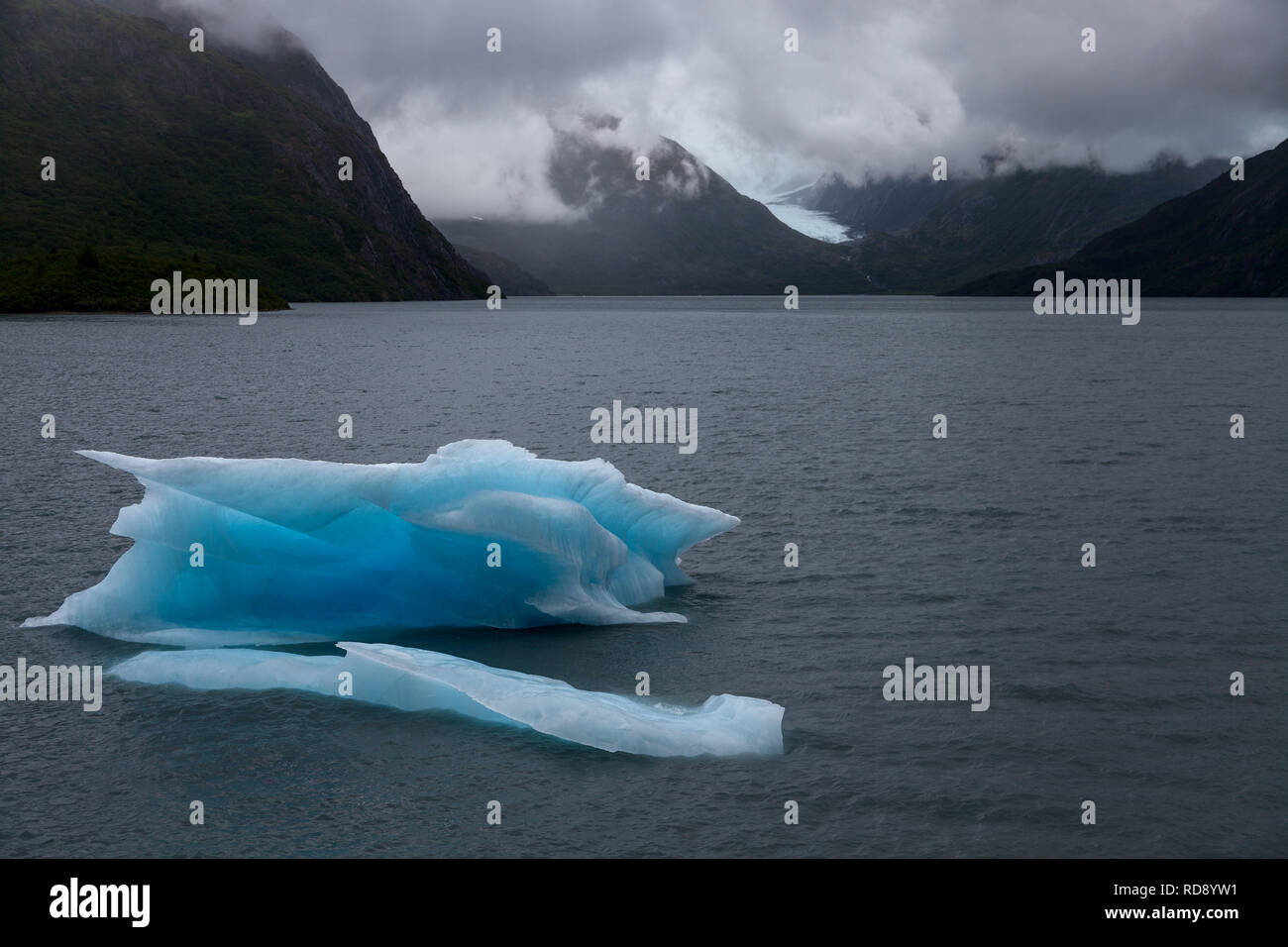 A large iceberg floats in the glacier-fed waters of Portage Lake in Alaska. - Stock Image