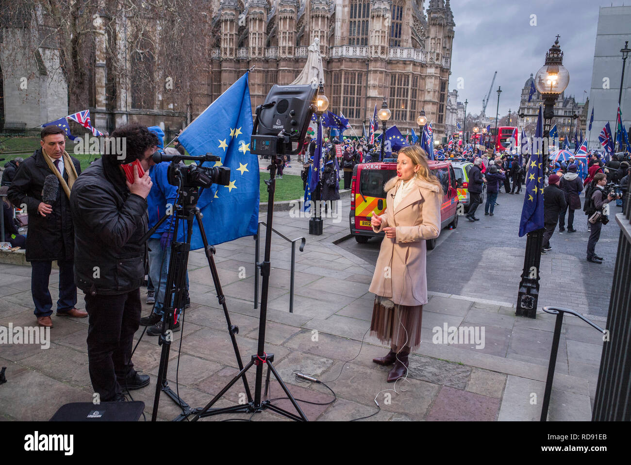 TV and Radio media and protesters on college green opposite westminster on the day of Theresa May's brexit plan defeat - Stock Image