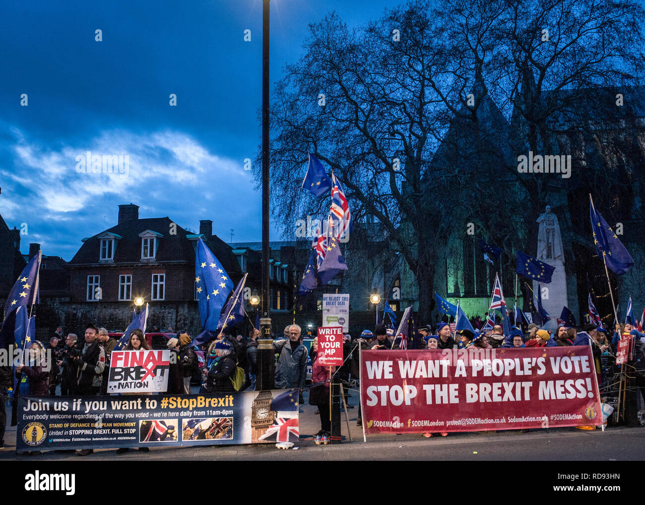 media and protesters on college green opposite westminster on the day of Theresa May's brexit plan defeat - Stock Image
