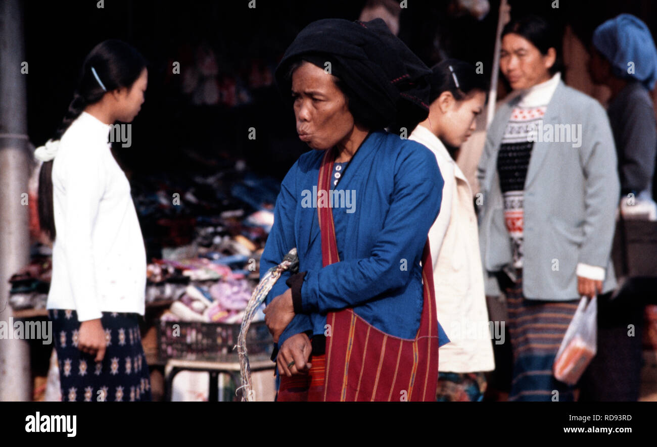 An indigenous Wa woman shopping at the local market near her village in Shan State, Burma (Myanmar). - Stock Image