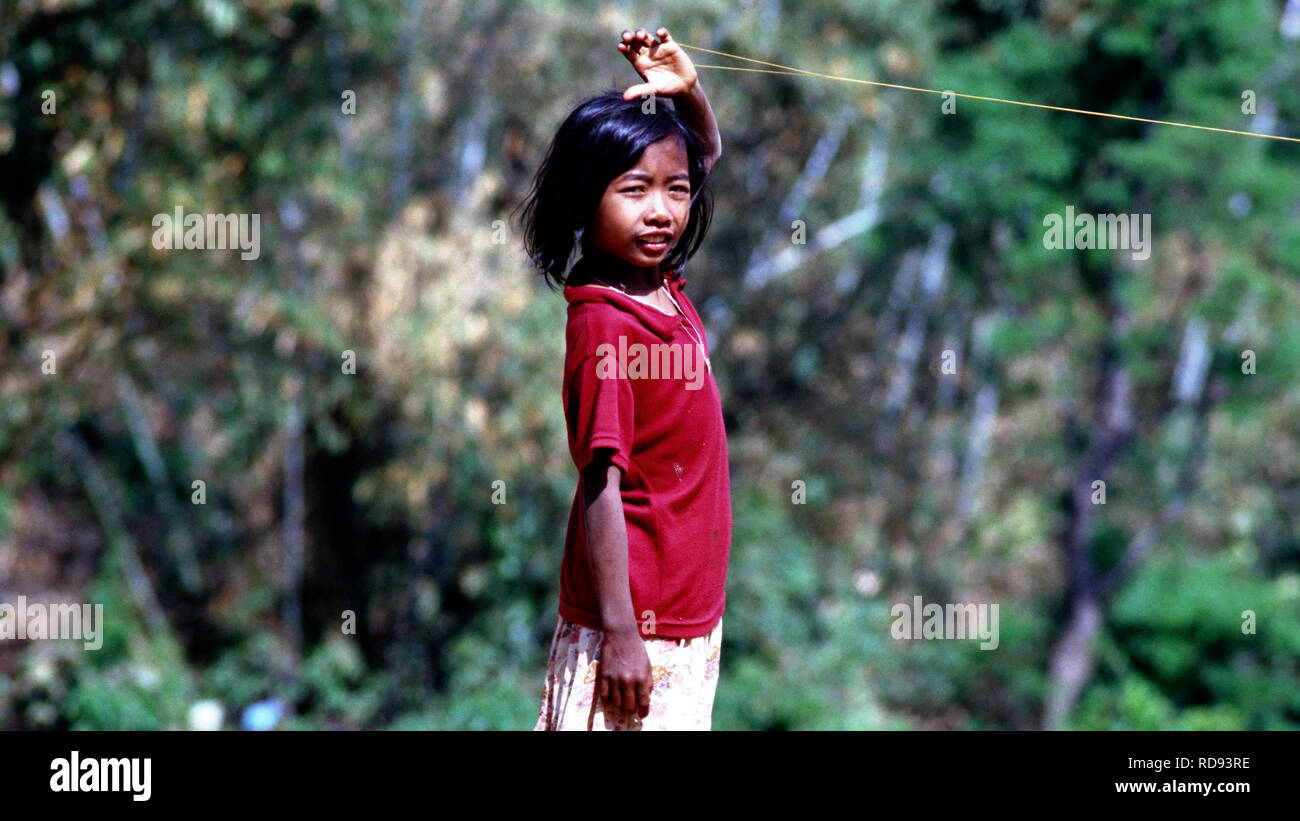 A young indigenous Wa girl playing in her village in Burma (Myanmar). - Stock Image
