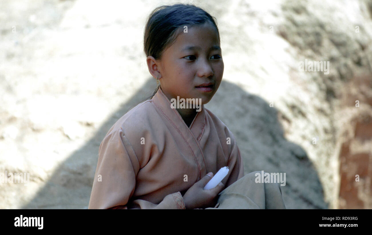 A young indigenous Wa girl in her village in Shan State, Burma (Myanmar). - Stock Image