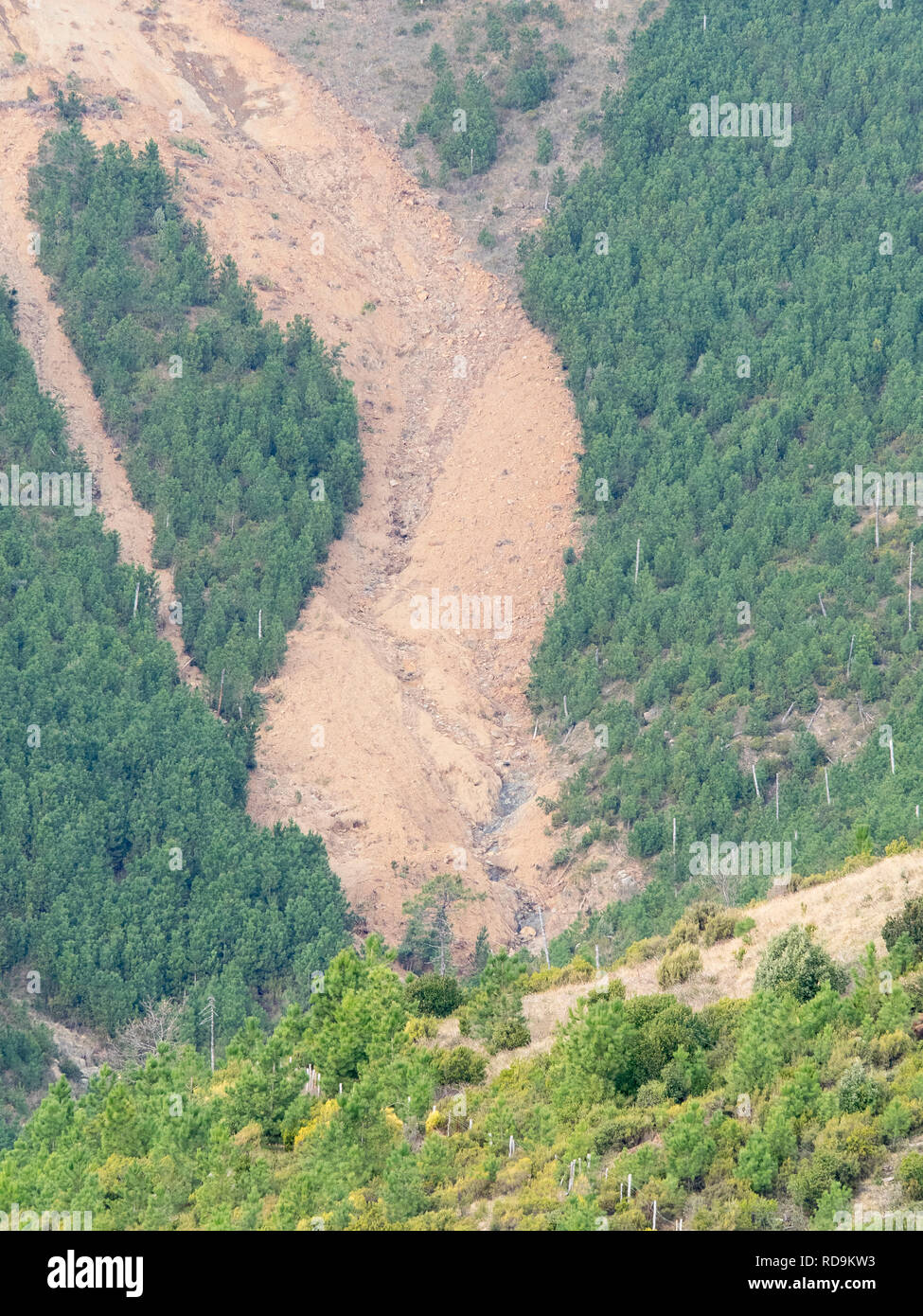 big landslide on the side of a mountain: soil erosion symbol of hydrogeological instability - Stock Image