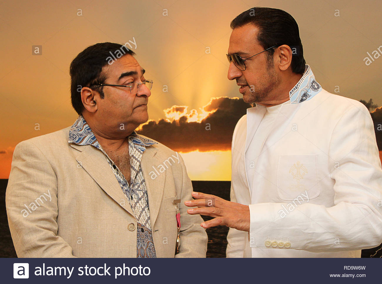 Homeopath Dr Mukesh Batra (L) with Bollywood actor Gulshan Grover at the inauguration of his 8th annual charity photgraphy exhibition in Mumbai, India on September 13, 2012. (SOLARIS IMAGES) - Stock Image