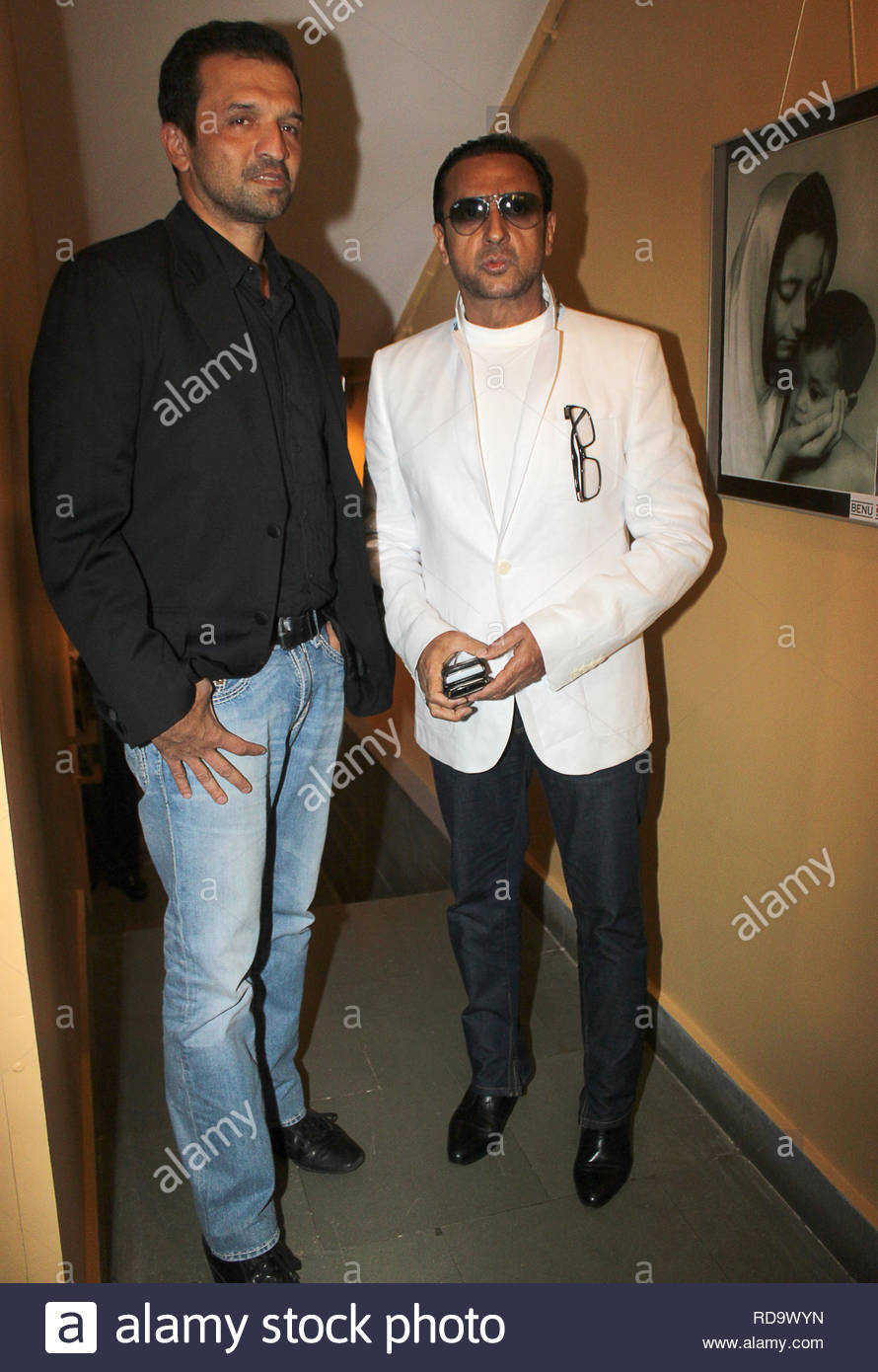Fashion photographer Atul Kasbekar and Bollywood actor Gulshan Grover at the inauguration of Homeopath Dr Mukesh Batra's (not in picture) 8th annual charity photgraphy exhibition in Mumbai, India on September 13, 2012. (SOLARIS IMAGES) - Stock Image