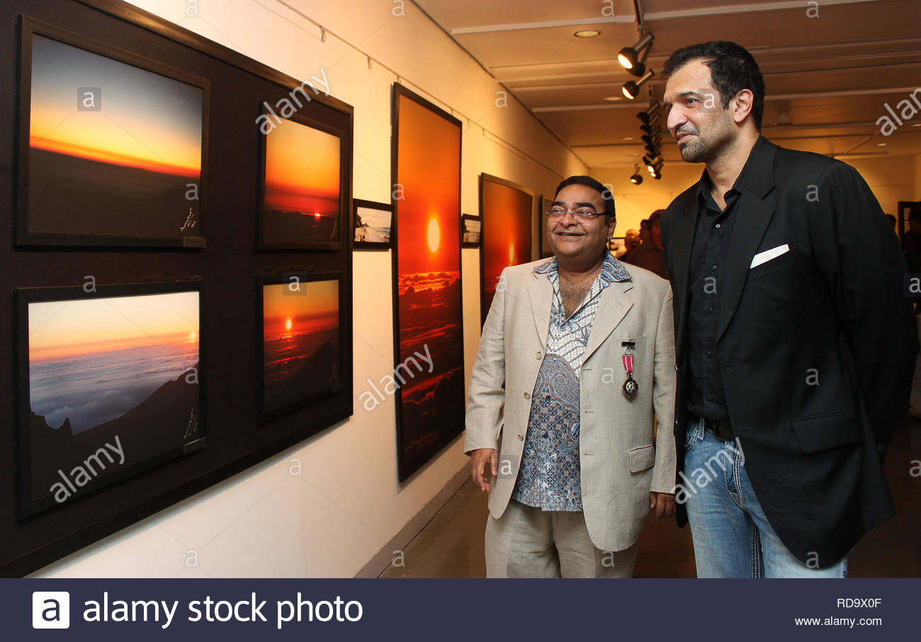 Homeopath Dr Mukesh Batra (L) with Fashion photographer Atul Kasbekar at the inauguration of his 8th annual charity photgraphy exhibition in Mumbai, India on September 13, 2012. (SOLARIS IMAGES) - Stock Image