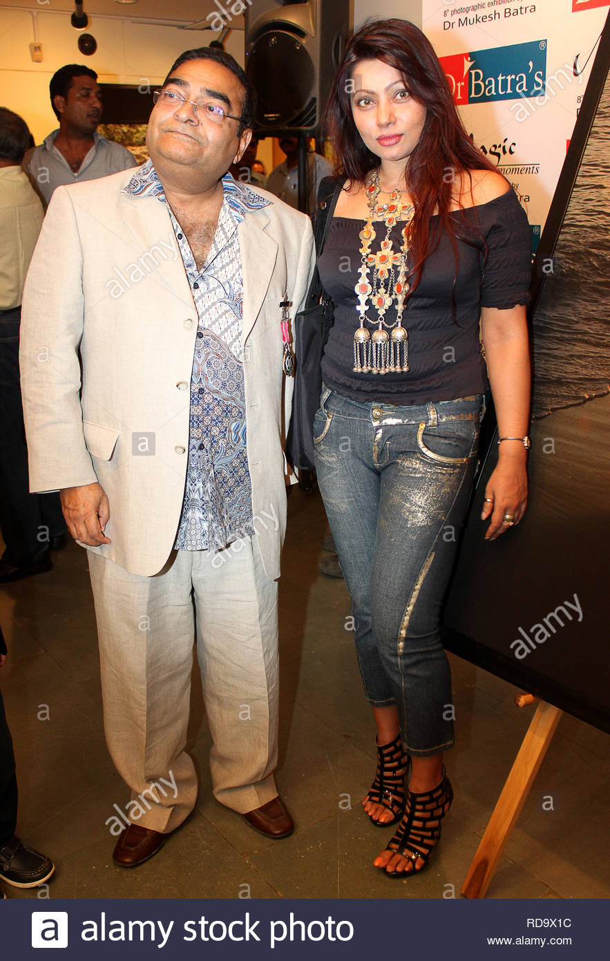 Homeopath Dr Mukesh Batra (L) with Bollywood actress Ananya Dutta at the inauguration of his 8th annual charity photgraphy exhibition in Mumbai, India on September 13, 2012. (SOLARIS IMAGES) - Stock Image