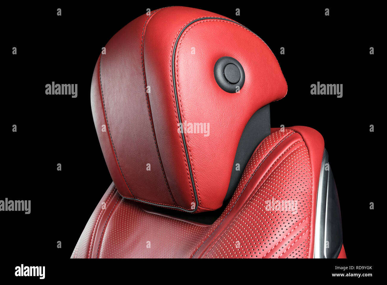 Modern Luxury car inside. Interior of prestige modern car. Comfortable leather seats. Red perforated leather cockpit with isolated Black background. M - Stock Image