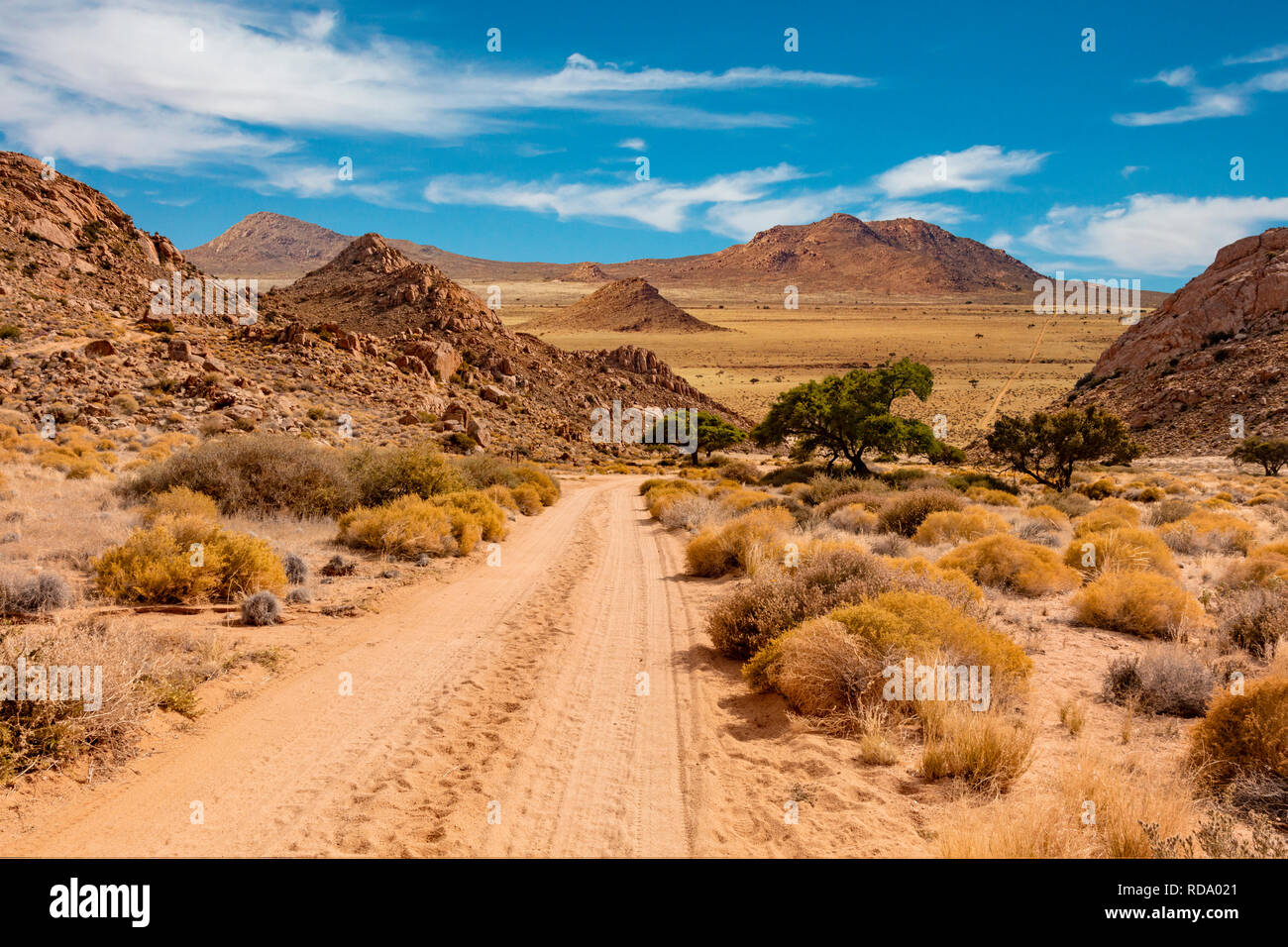 Namibia landscape with unprepared road leading to nowhere. - Stock Image