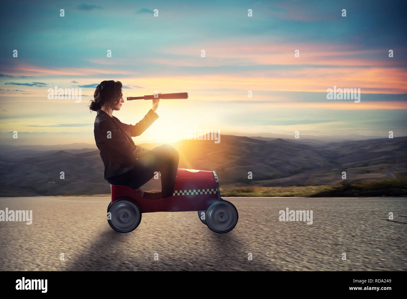Businesswoman with telescope on a car looks for new business opportunity - Stock Image