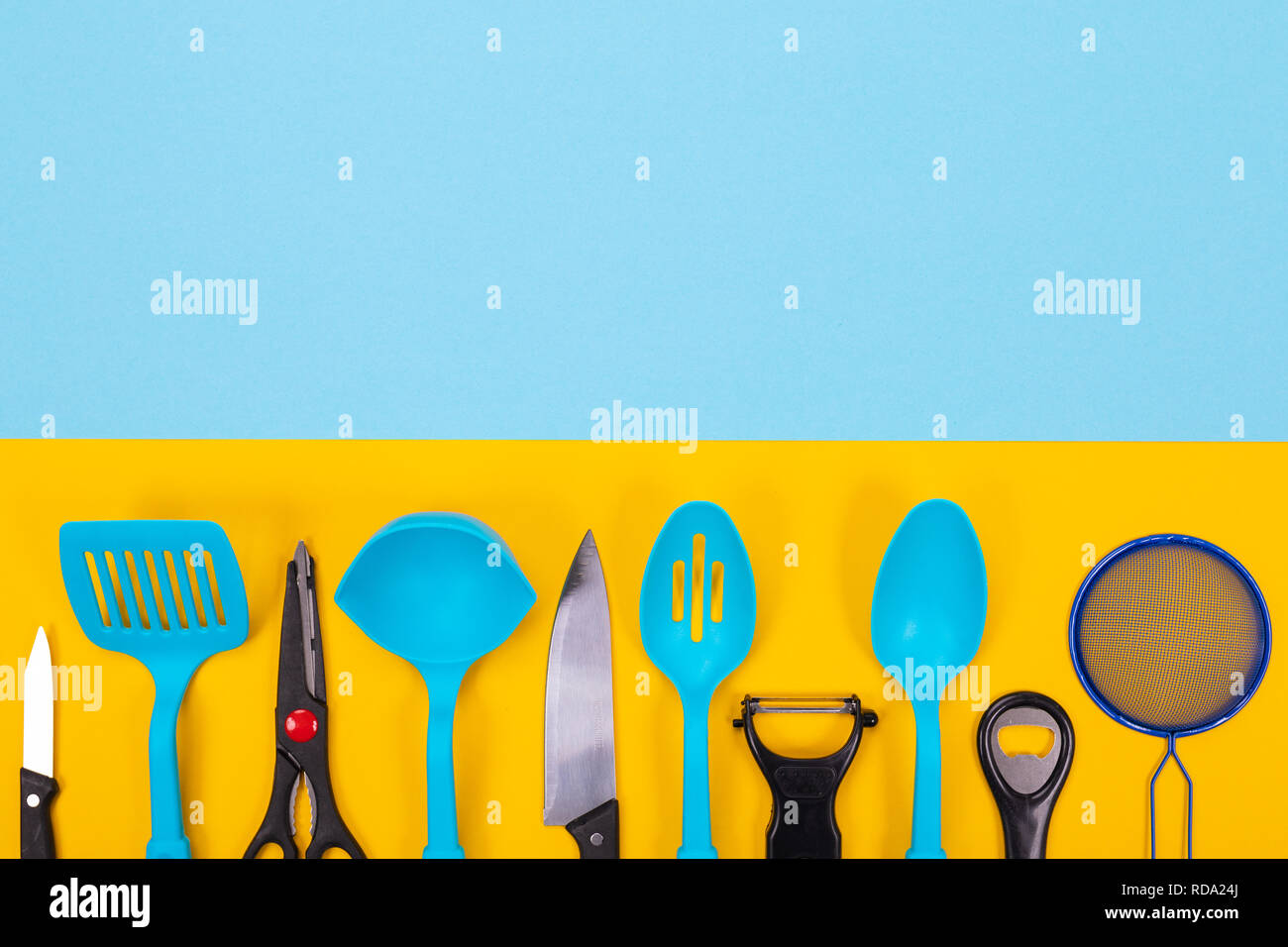 Design Concept Of Kitchen Utensils Isolated With Copyspace On Blue Yellow Background Stock Photo Alamy