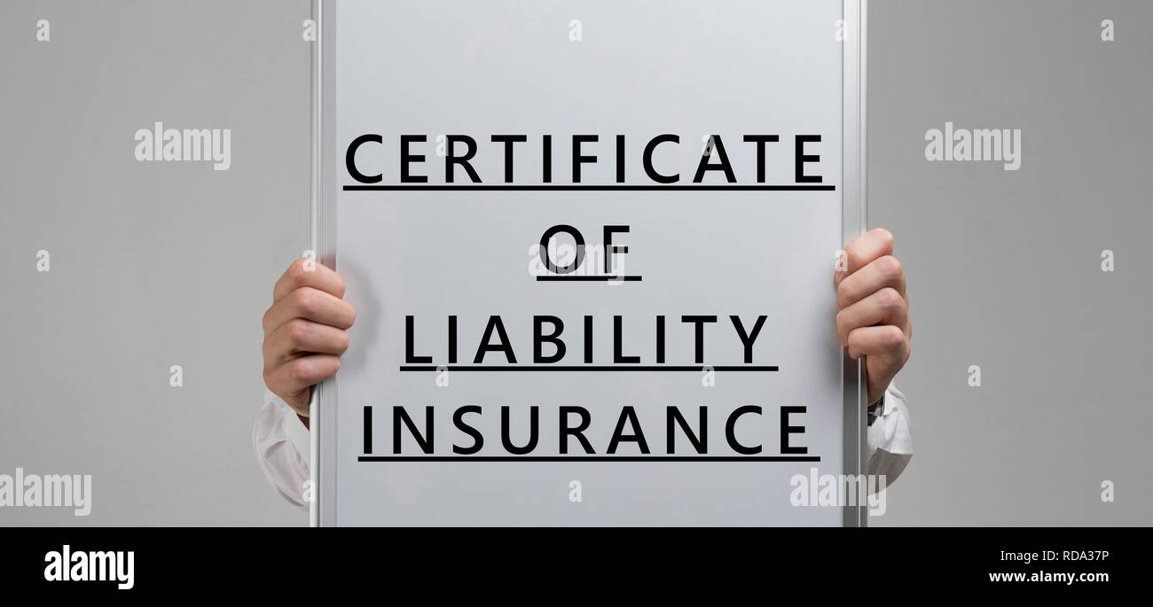 men's hands holding a poster with the inscription certificate of liability insurance isolated on light background - Stock Image