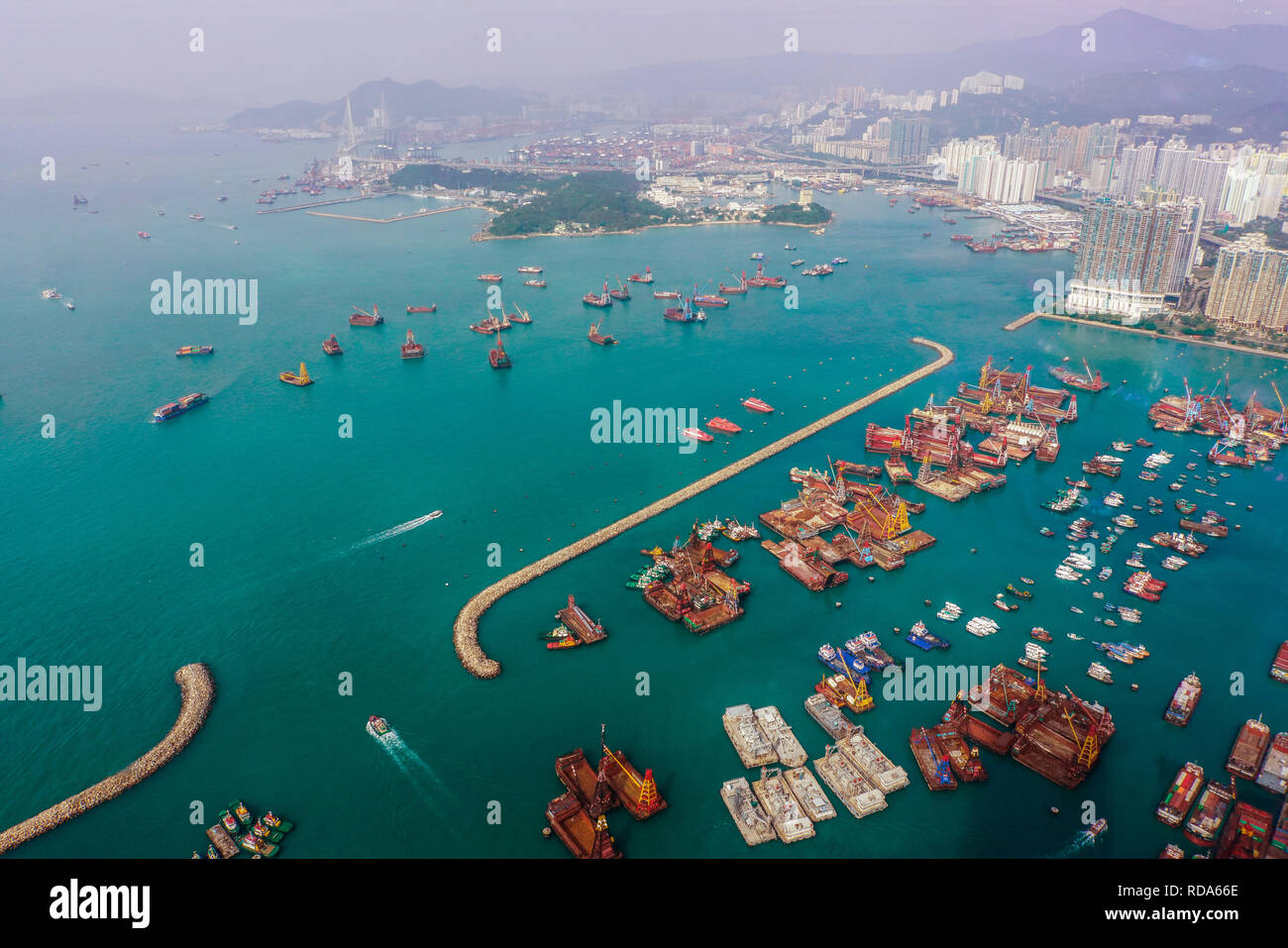 Aerial view of harbour with urban skyscrapers and sea. Hong Kong, China. - Stock Image