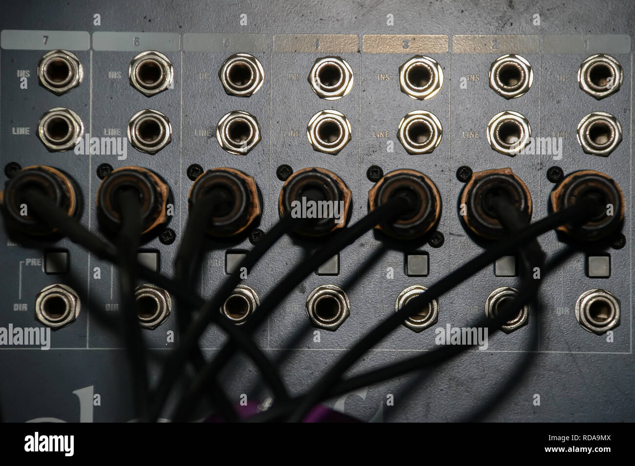 Close up of jack cable connected at rear of switcher sound mixer control panel Stock Photo