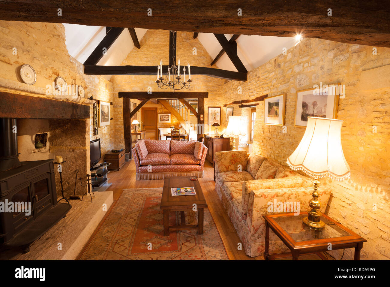 Interior Of A Traditional French Farmhouse Living Room With Stone Walls And Large Firplace Stock Photo Alamy