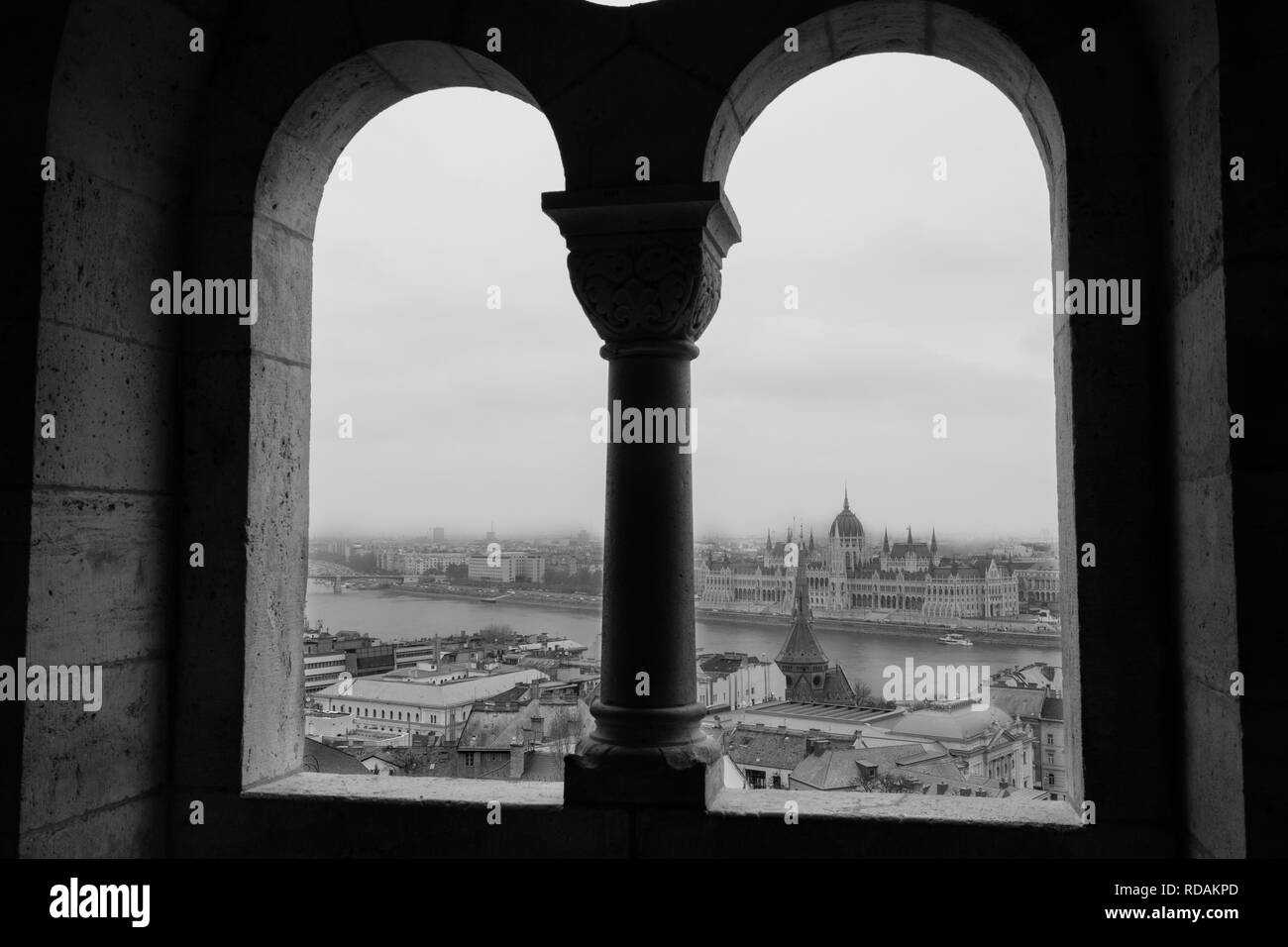 The view of the Hungarian Parliament Building and Pest from the window of Halászbástya. - Stock Image