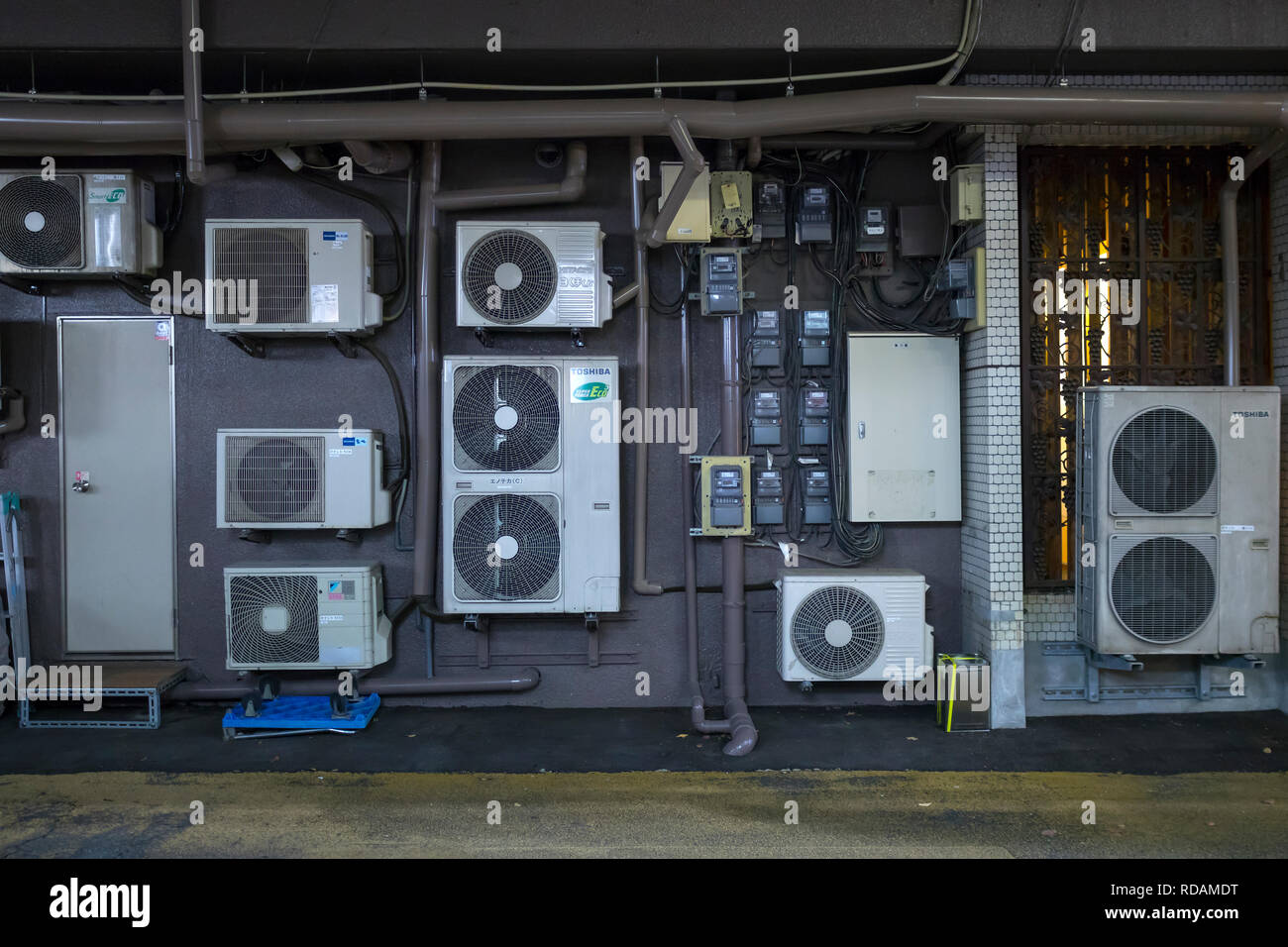 Kumamoto, Japan - November 10, 2018:  Outdoor electricity supply and air conditioning units in Kumamoto - Stock Image