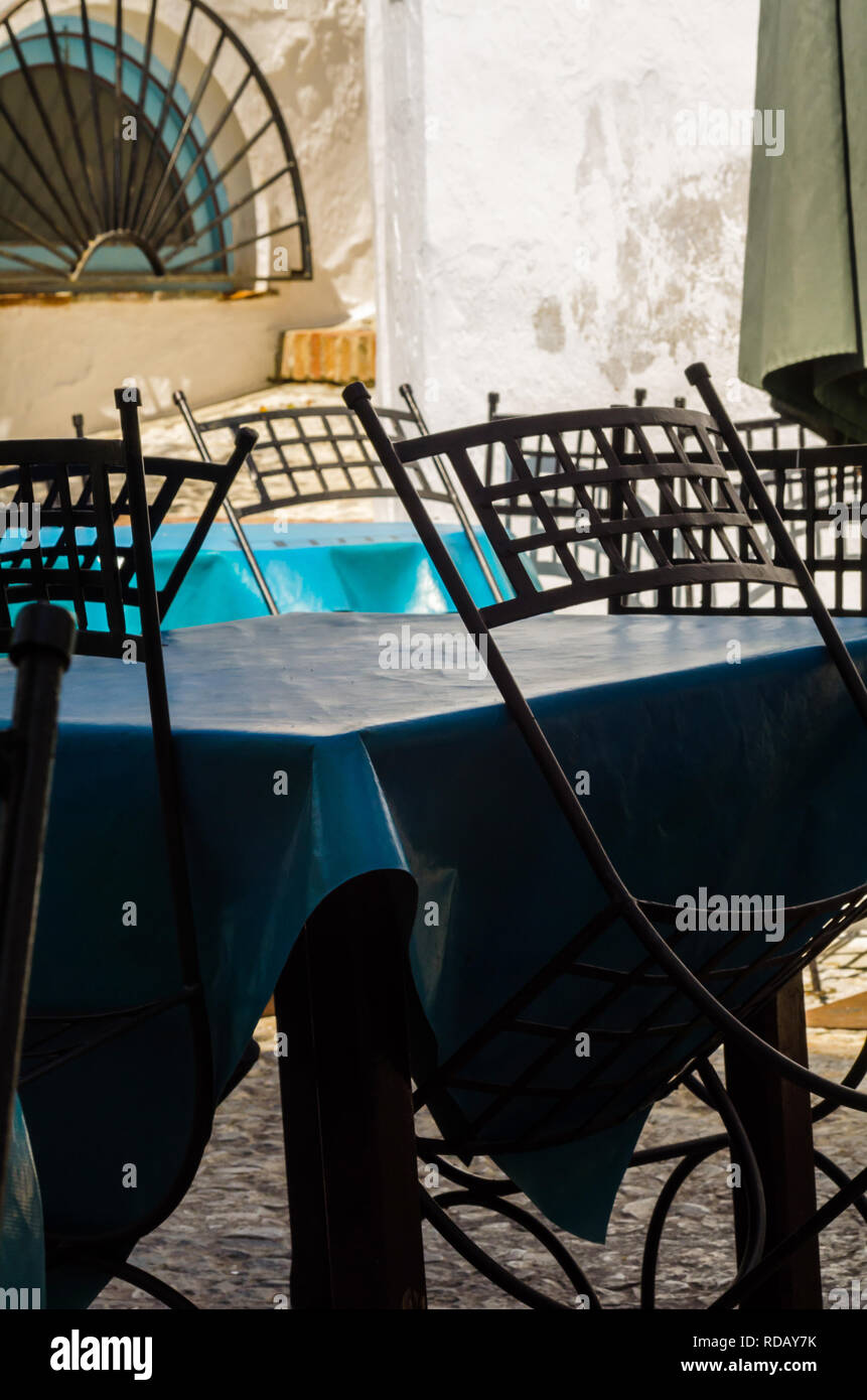 Empty tables and chairs in front of the restaurant place to serve meals outside the restaurant, catering industry - Stock Image