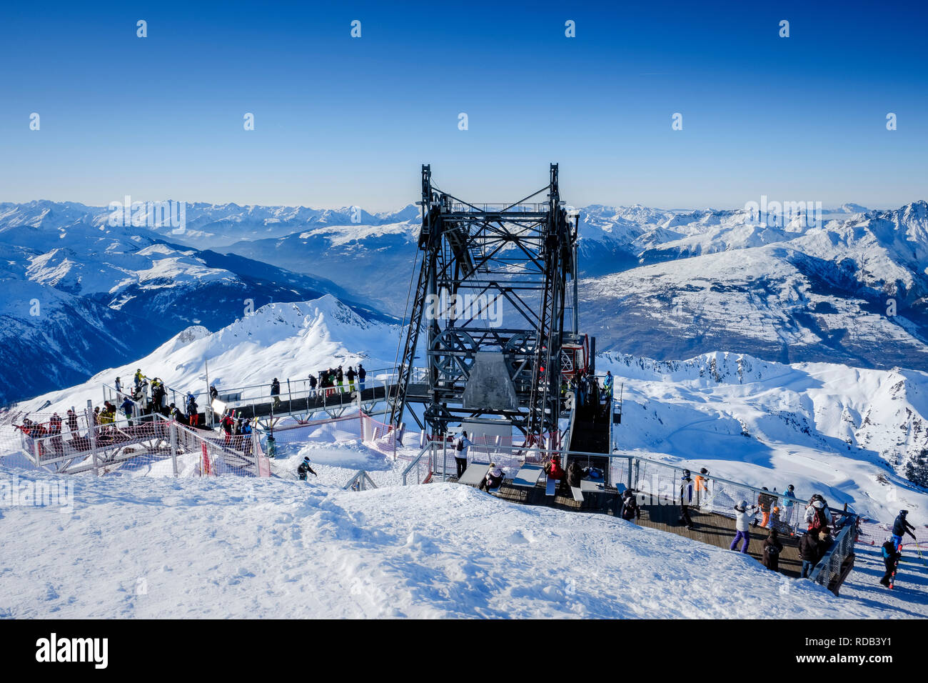 The lift station at Aiguille Rouge, with people enjoying the panoramic view of the Alps. - Stock Image
