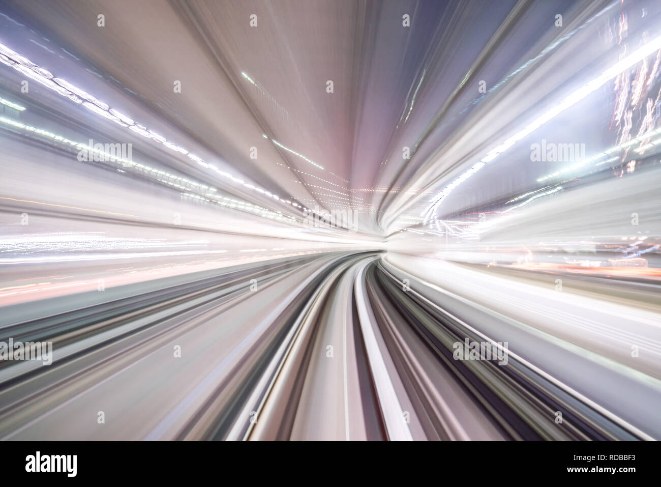 Motion blur of train moving inside tunnel with daylight in tokyo, Japan. Stock Photo