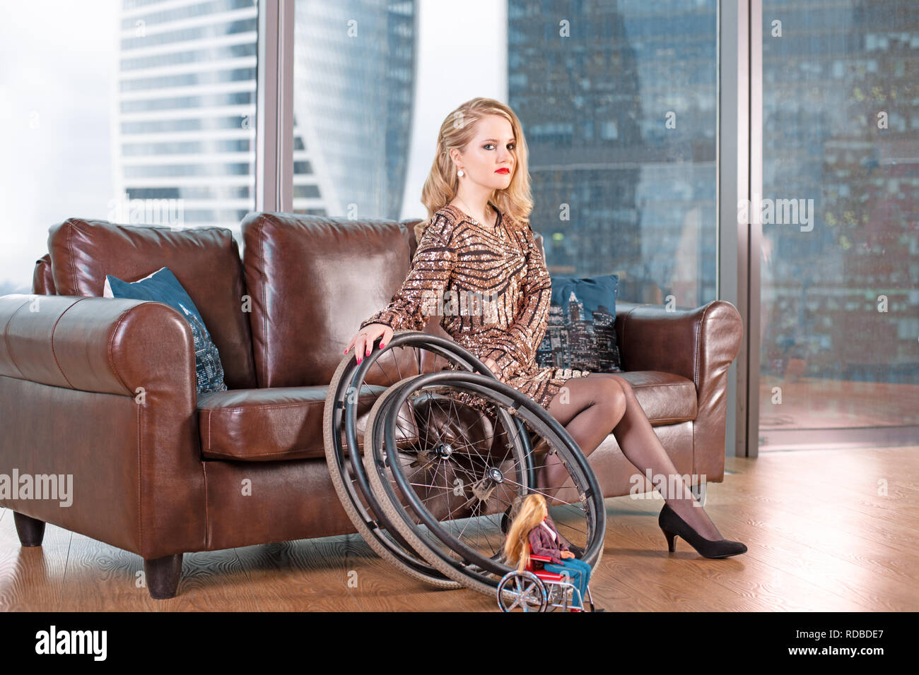 Cool A Beautiful Young Blonde Girl In A Fashionable Dress With A Onthecornerstone Fun Painted Chair Ideas Images Onthecornerstoneorg