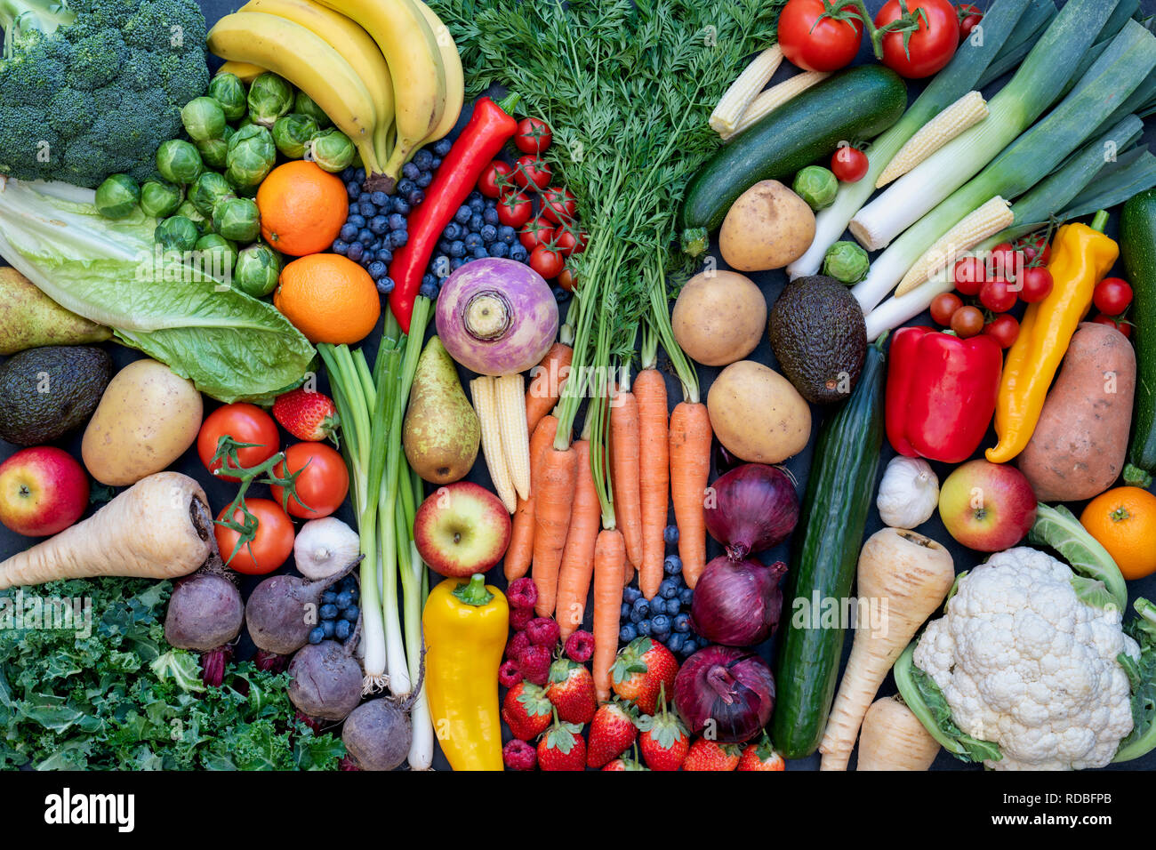 Fruit and vegetables on slate pattern - Stock Image