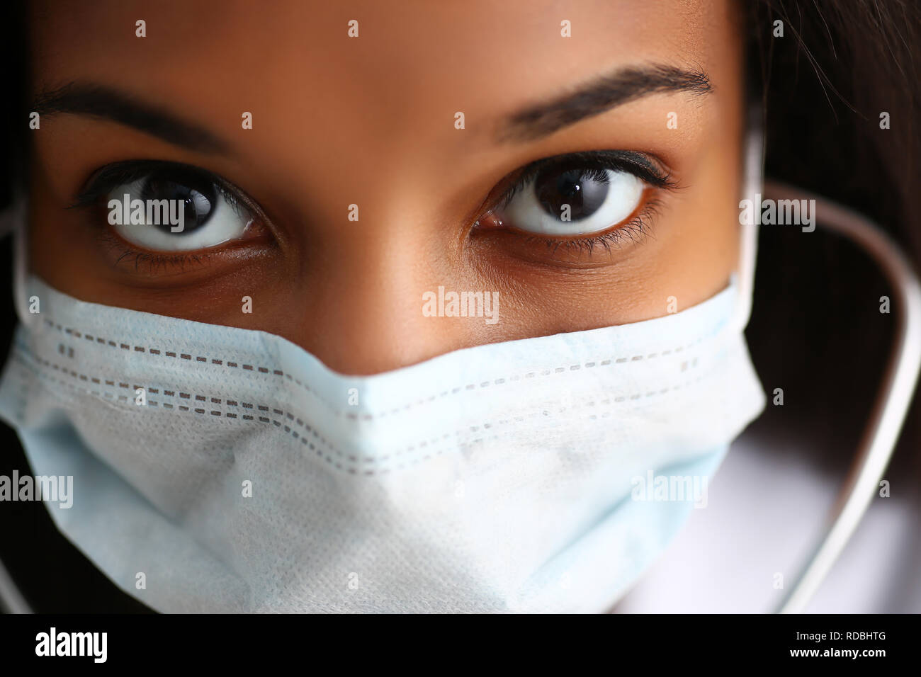 Black female doctor in a face mask - Stock Image