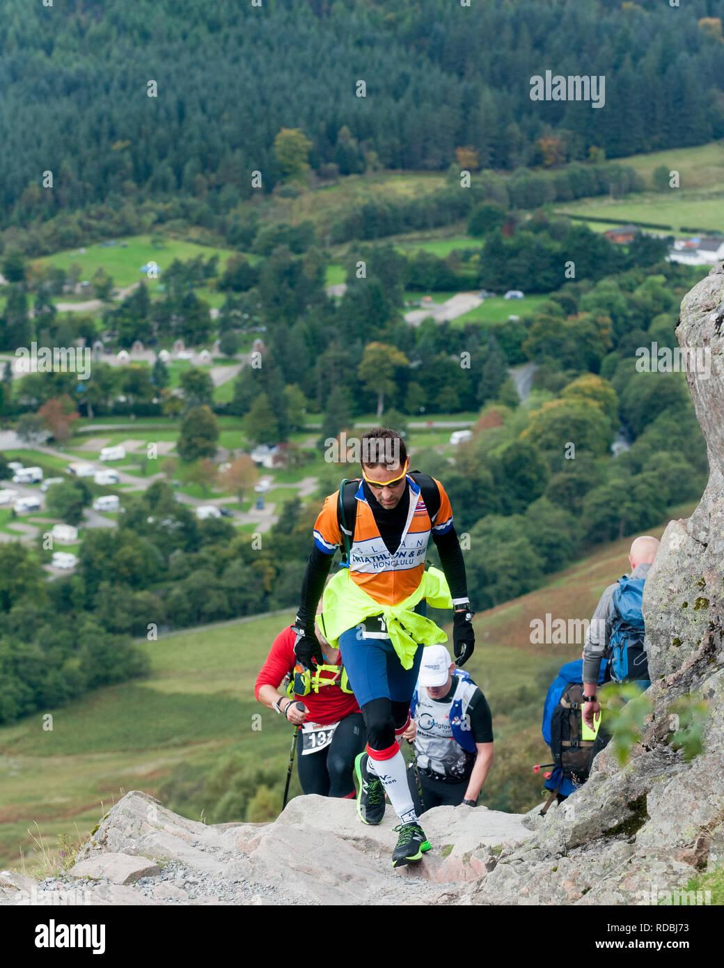 Man walking up Ben Nevis path Glen Nevis highlands Scotland U.K - Stock Image