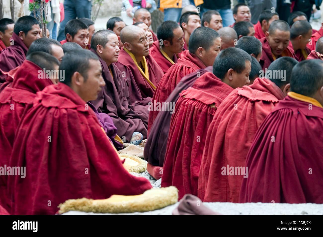 debating monks in Lhasa Tibet Stock Photo
