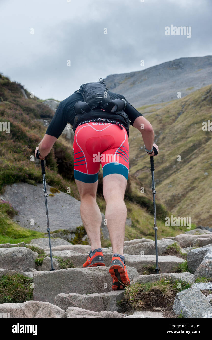 Male walking up the ben nevis path seen from behind - Stock Image