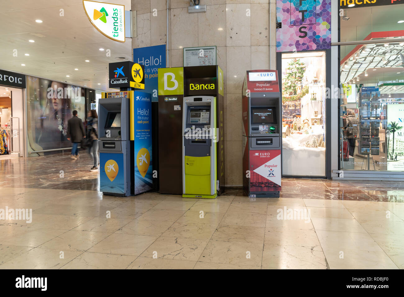 ATM of the Banco Popular, Bankia and Caixa Bank placed in the train station of Barcelona Sants, Servired, visa, euro6000, American Express, withdrawal - Stock Image