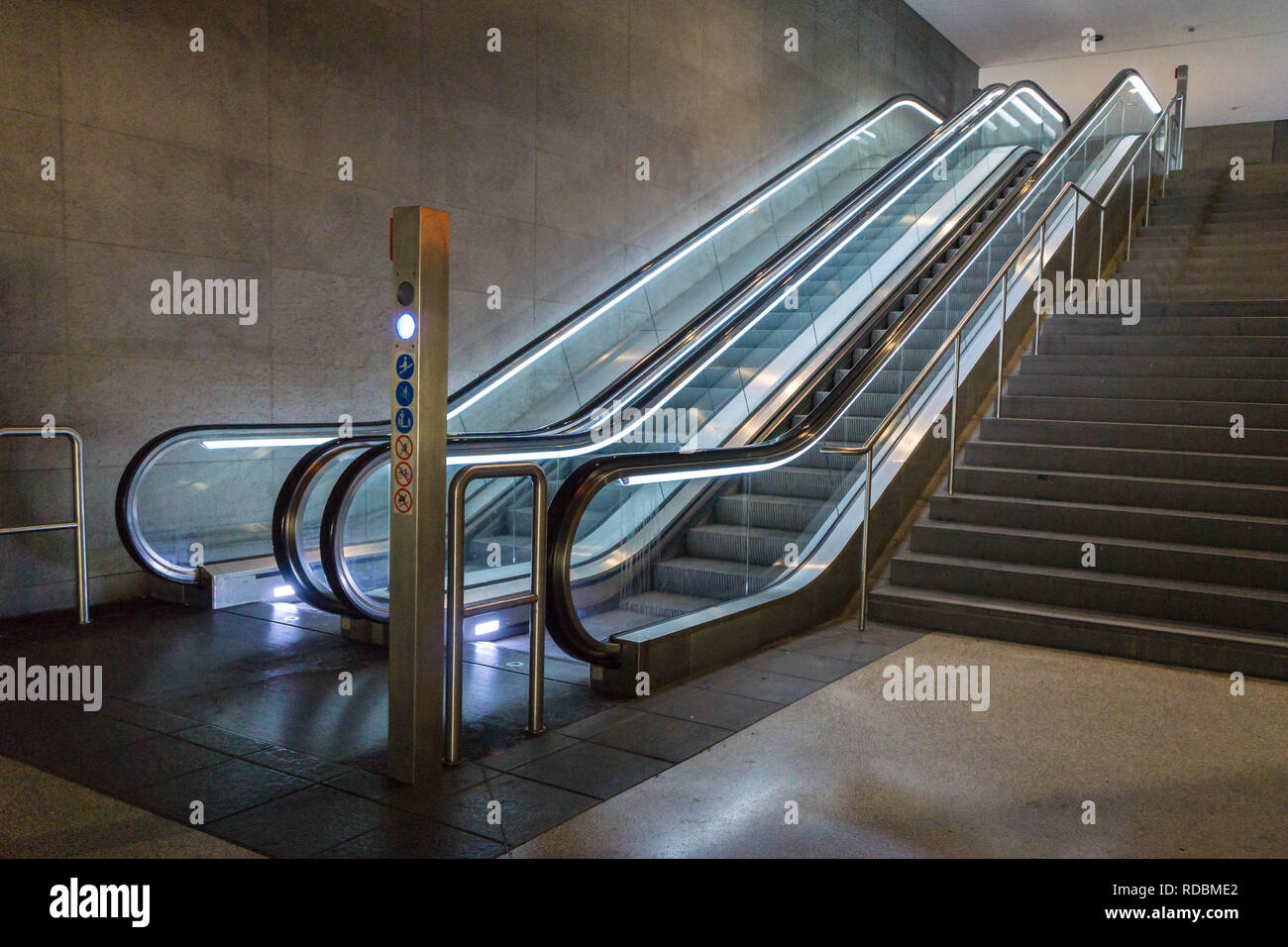 subway escalators or rolling stairways - moving stairs - Stock Image