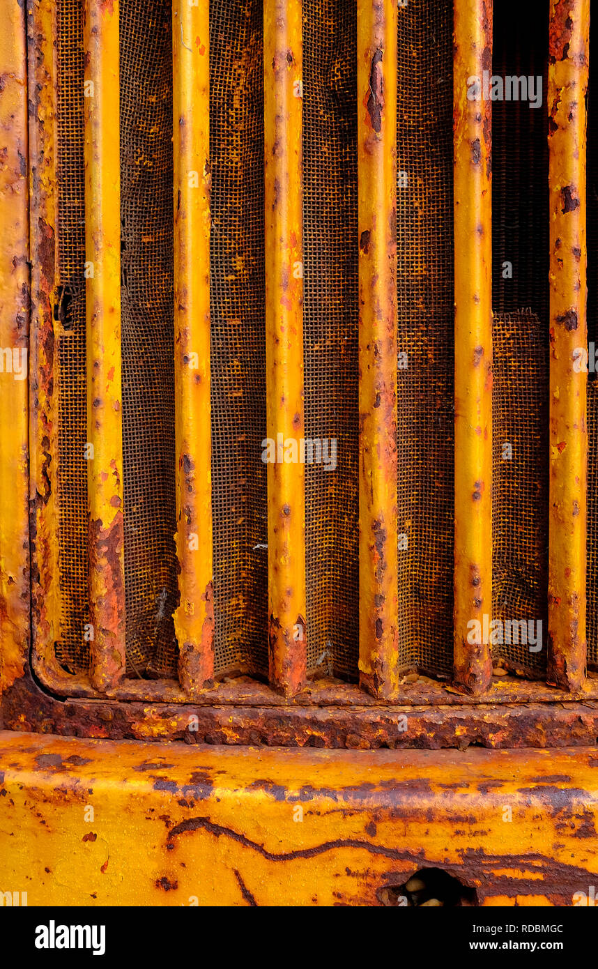 radiator grille on old rusty tractor - Stock Image