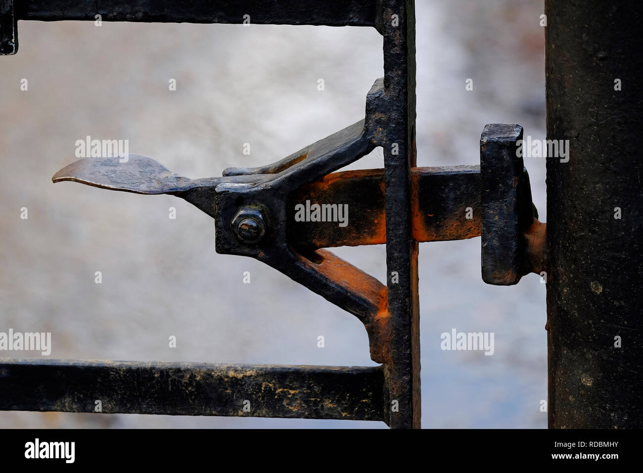 old metal rusty gate latch lever - Stock Image